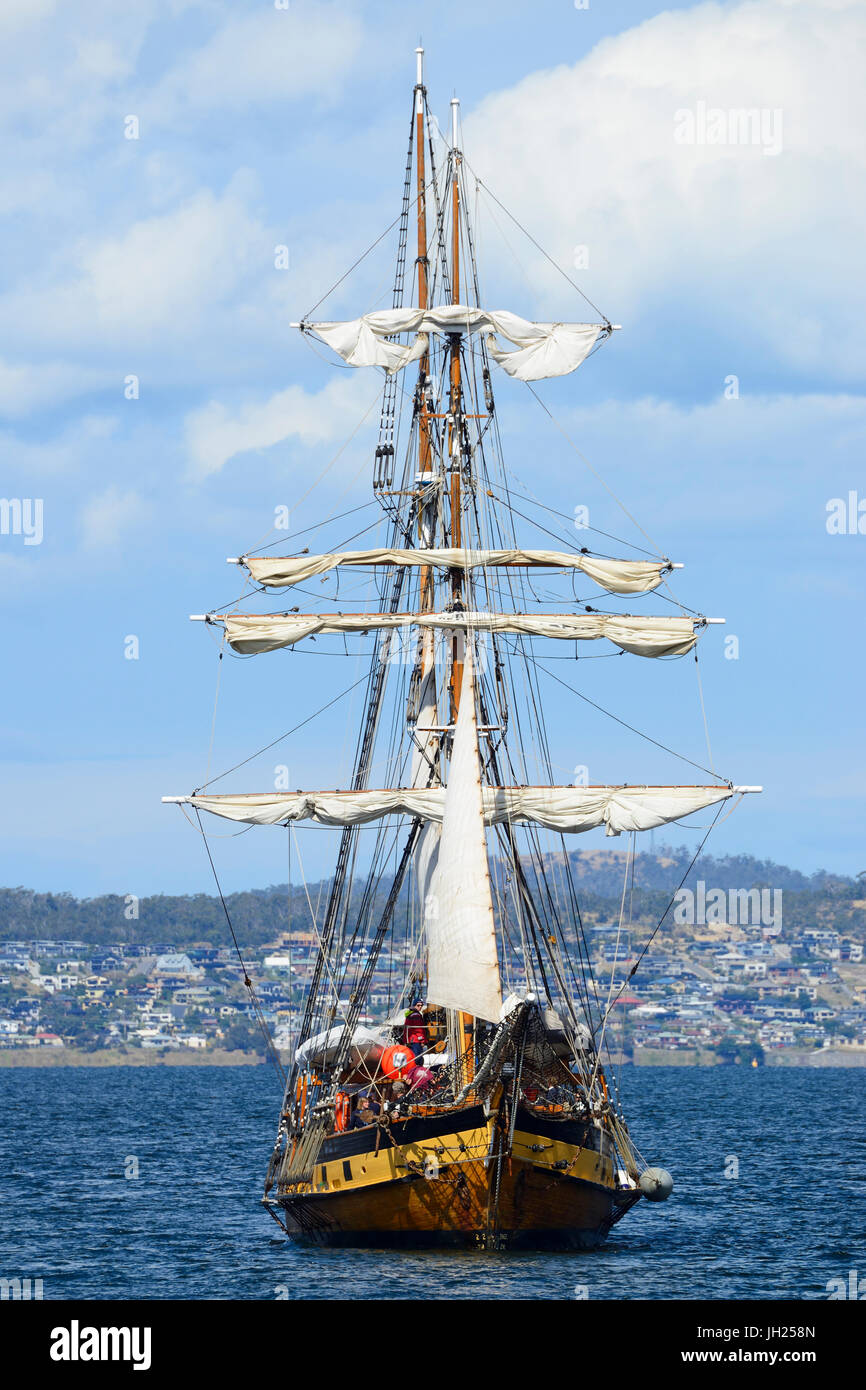 Two-masted square rigged tall ship 'Windeward Bound' furls sails as it approaches Hobart harbour in Tasmania, - Stock Image