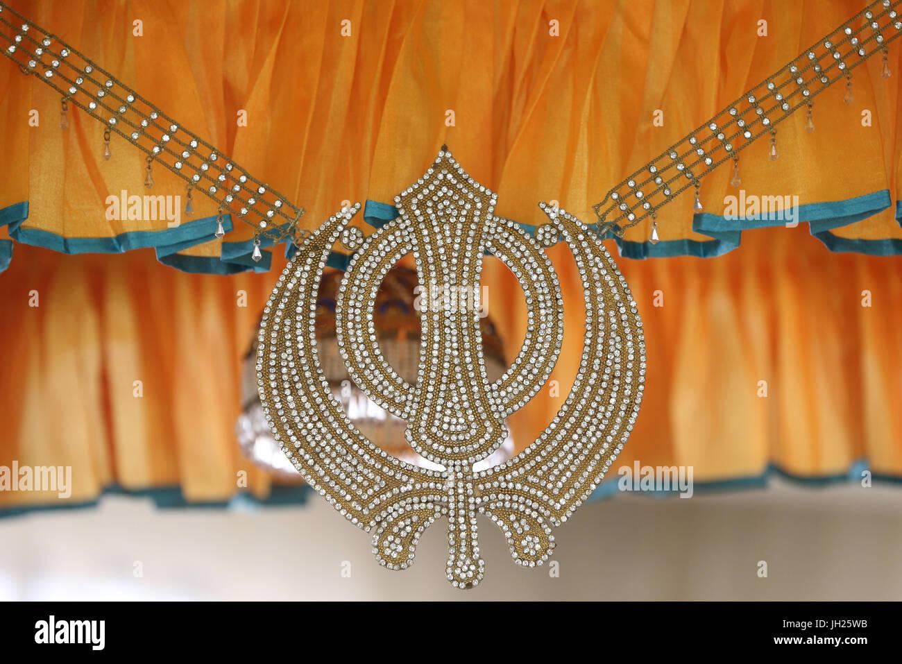 Gurdwara Sahib Silat Road ( Silat Road Sikh Temple ).  Khanda (Sikh symbol).  Singapore. Stock Photo