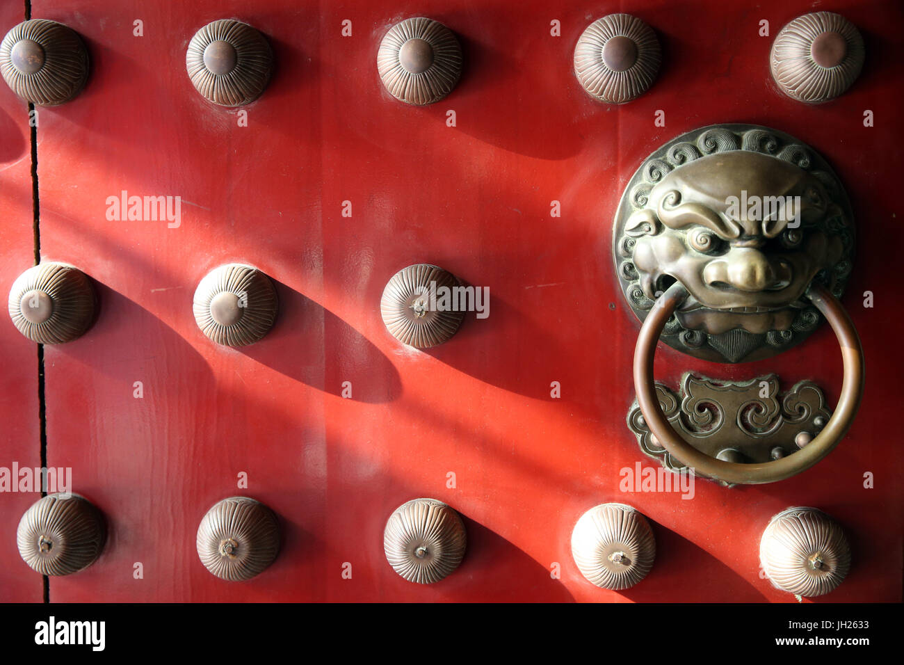 Buddha Tooth Relic Temple in Chinatown. Traditional red chinese door with a lion handle.  Singapore. - Stock Image