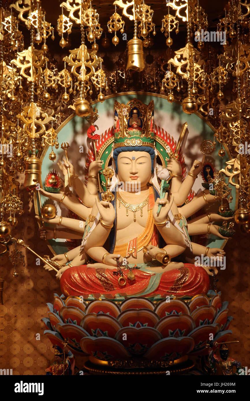 Buddha Tooth Relic Temple in Chinatown. Longevity Bodhisattva Samantabhadra statue.  Singapore. - Stock Image