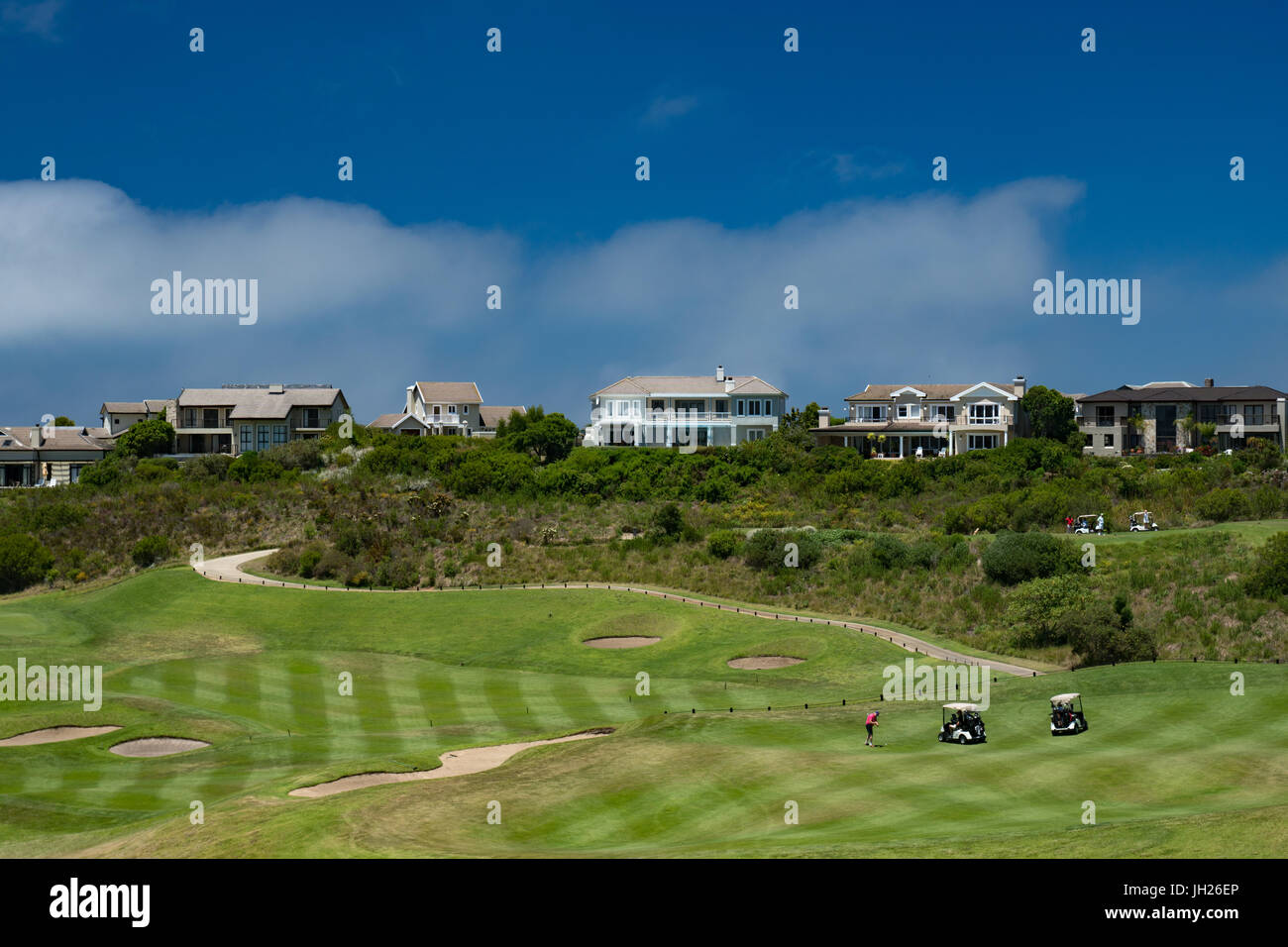 Midday golf being played at the Pezula Golf Course, Kynsna, South Africa, Africa - Stock Image