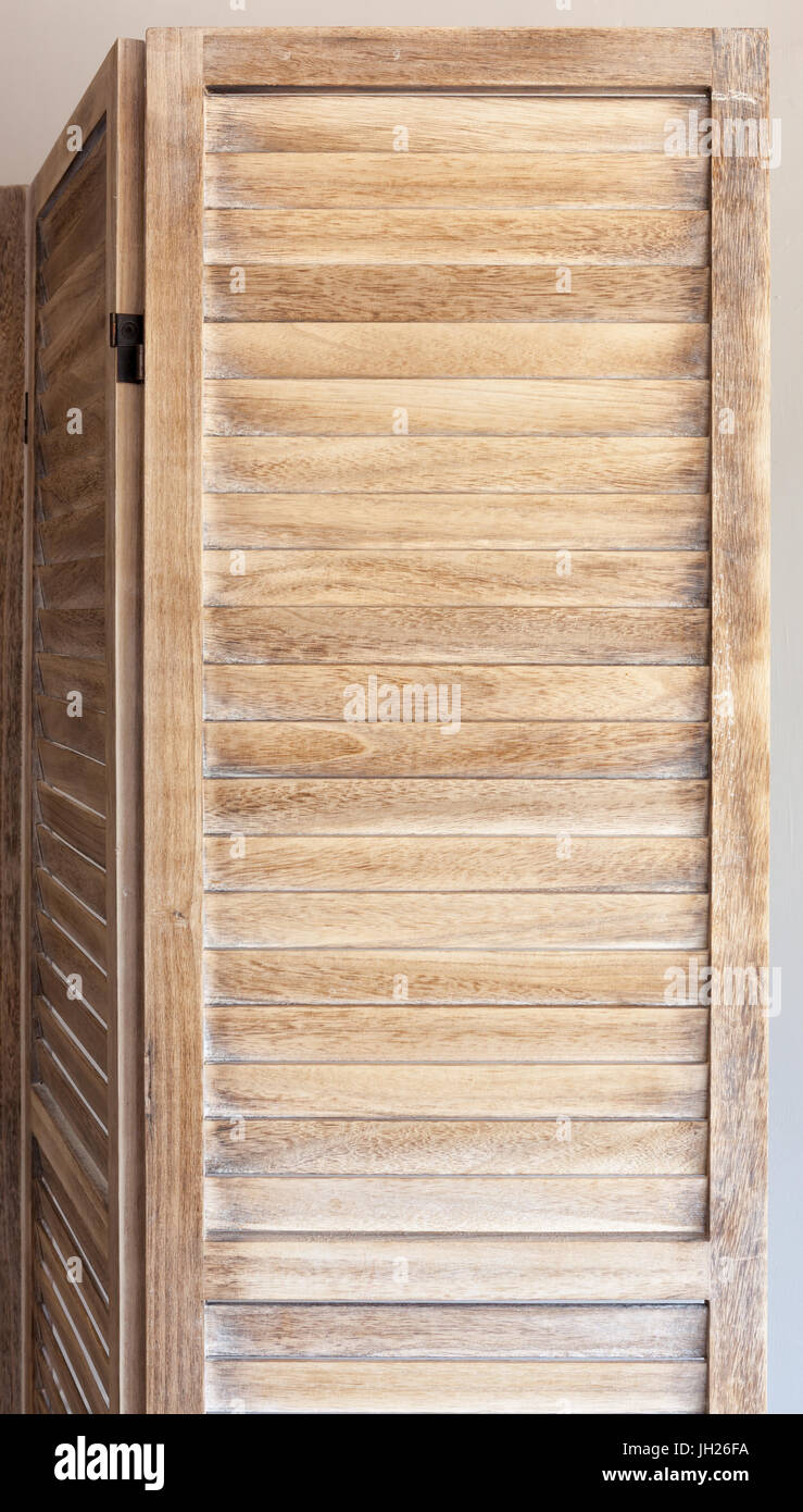 Close up of wooden folding screen on white background. Stock Photo