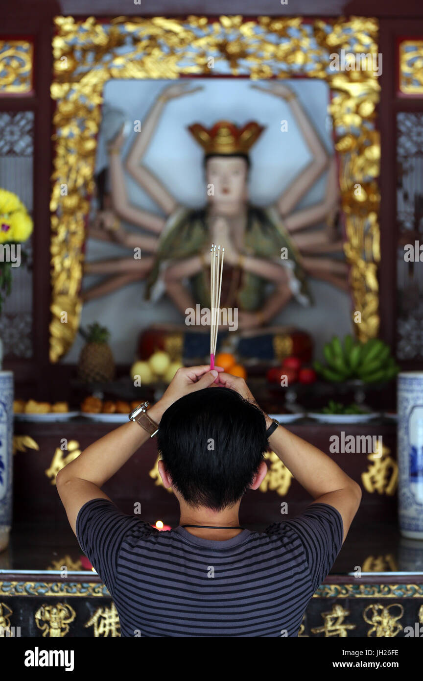 Thian Hock Keng Temple  A Chinese young man praying and