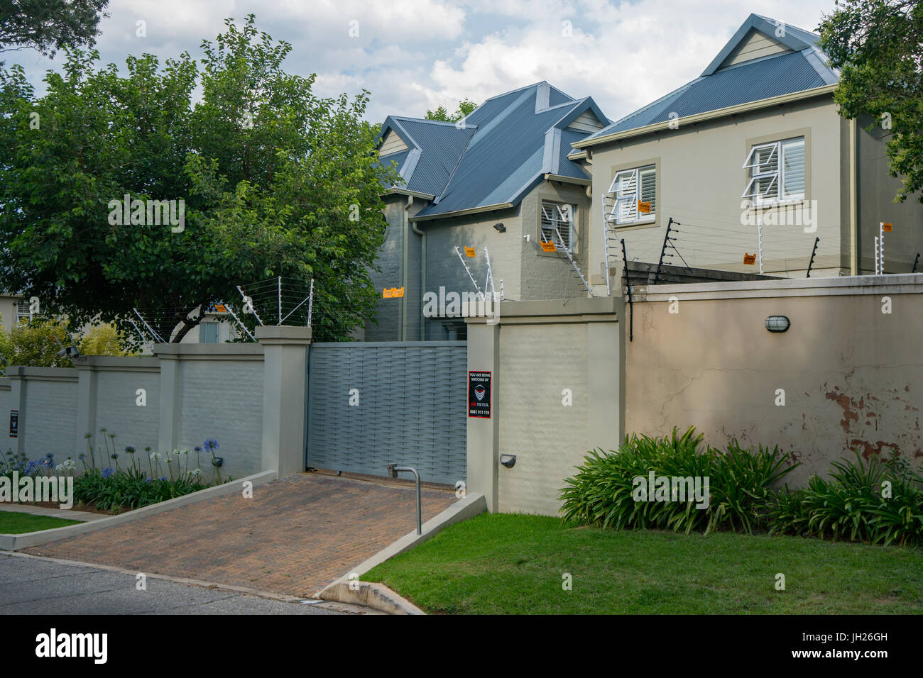 Typical major security precautions taken in prosperous residential Northern Suburbs, Johannesburg, South Africa, - Stock Image