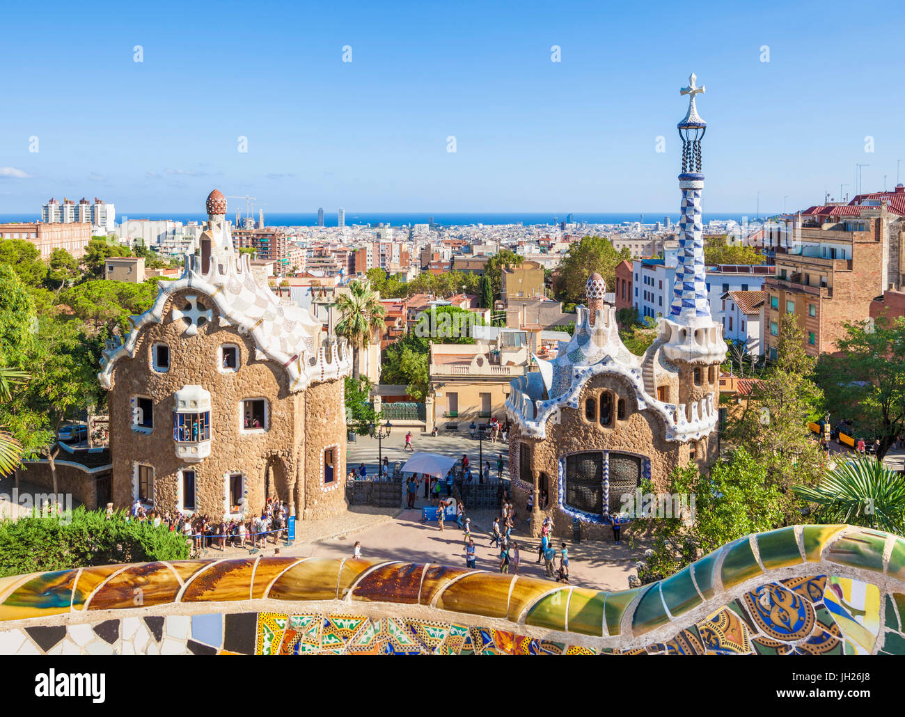 Entrance lodge to Parc Guell designed by Antoni Gaudi, UNESCO, with a skyline view of the city of Barcelona, Catalonia, - Stock Image