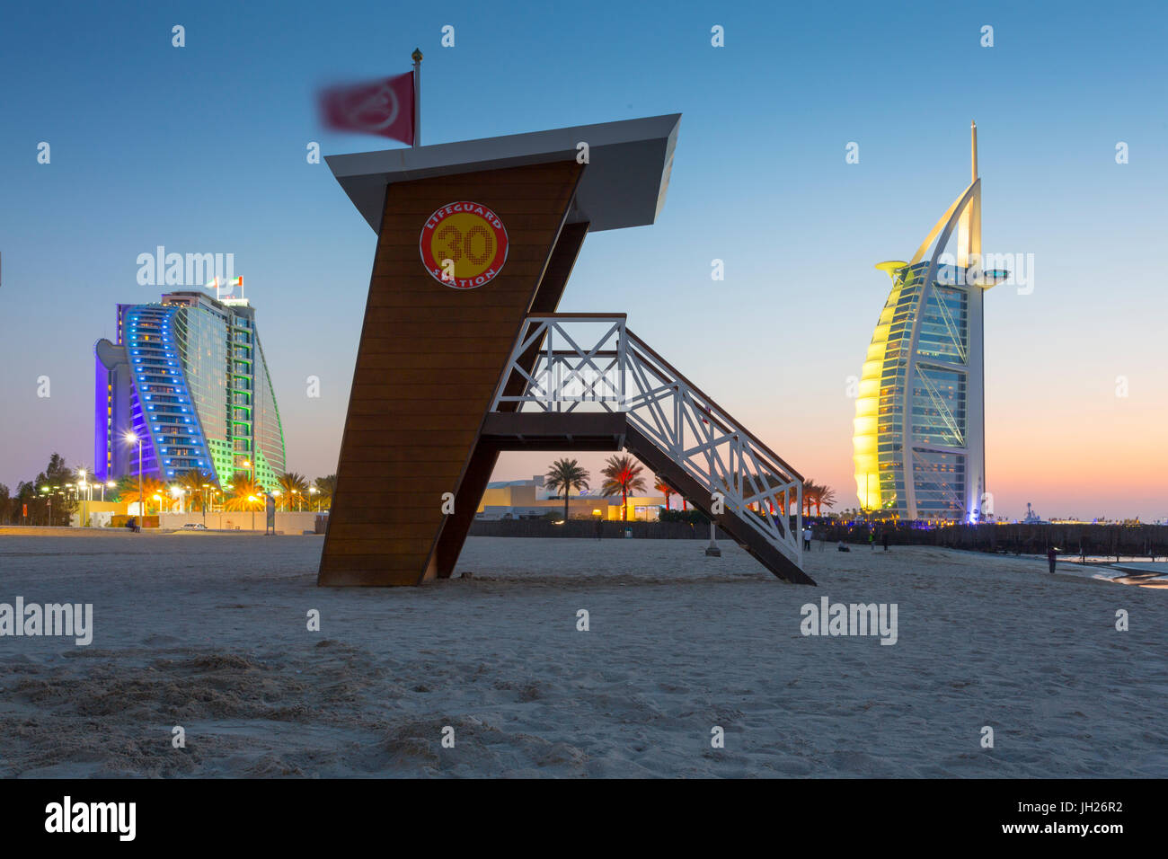 Burj Al Arab Hotel, sunset and lifeguard watchtower on Jumeirah Beach, Dubai, United Arab Emirates, Middle East - Stock Image