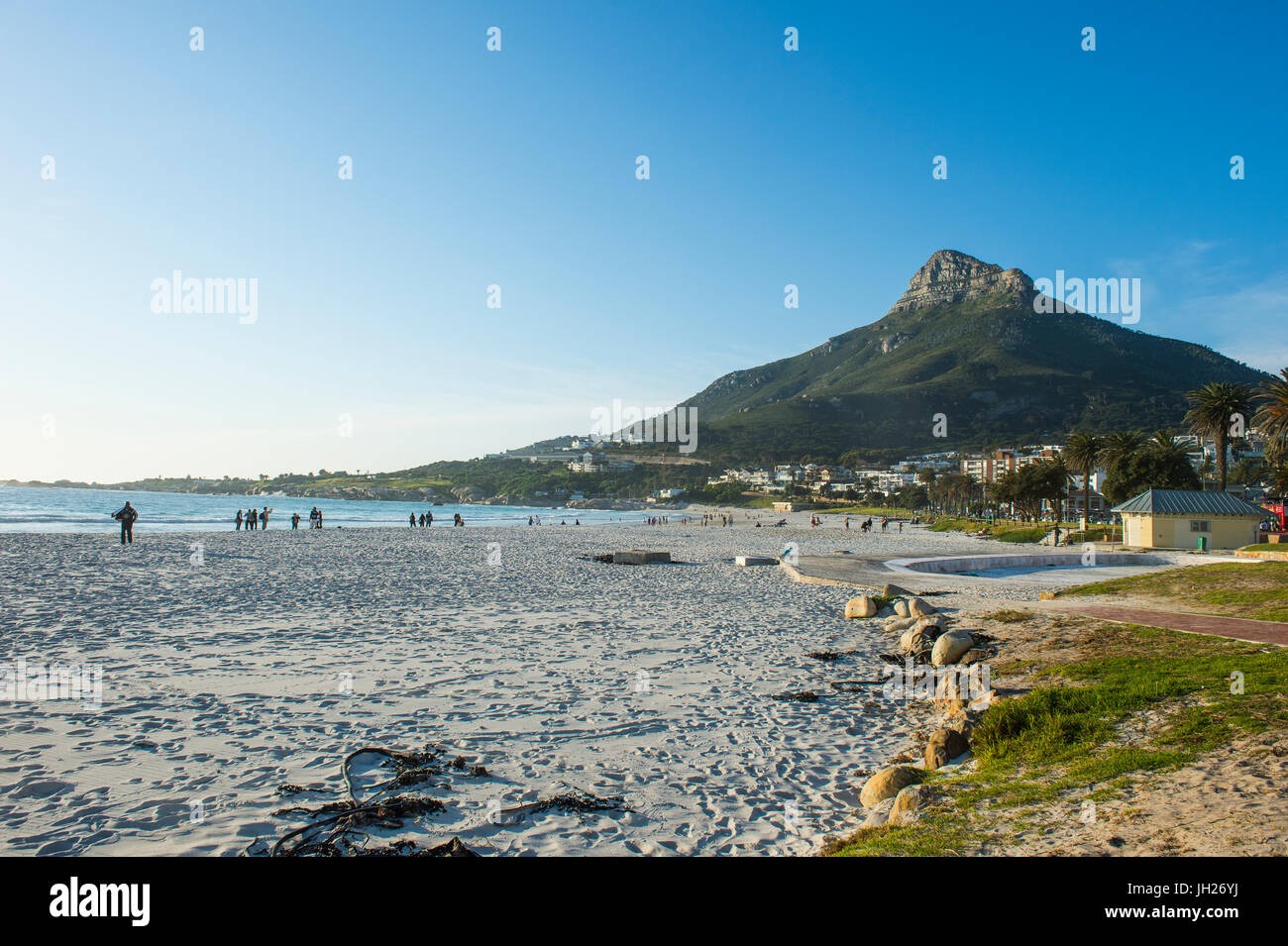 Waterfront of Camps Bay with the Lions Head in the background, suburb of Cape Town, South Africa, Africa - Stock Image