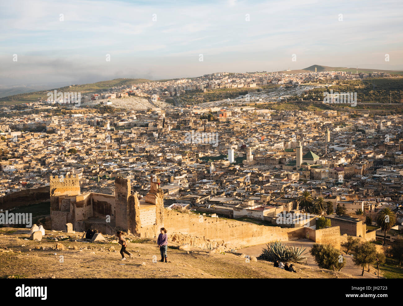 View over city from Merenid Tombs at sunset, Fes, Morocco, North Africa, Africa - Stock Image
