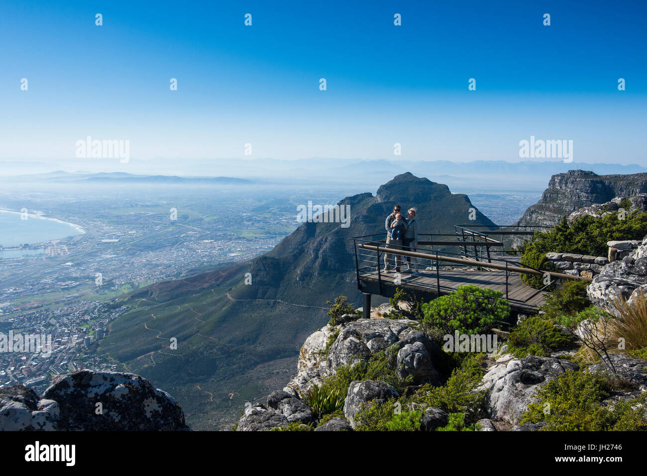 Family enjoying the view from Table Mountain over Cape Town, South Africa, Africa - Stock Image