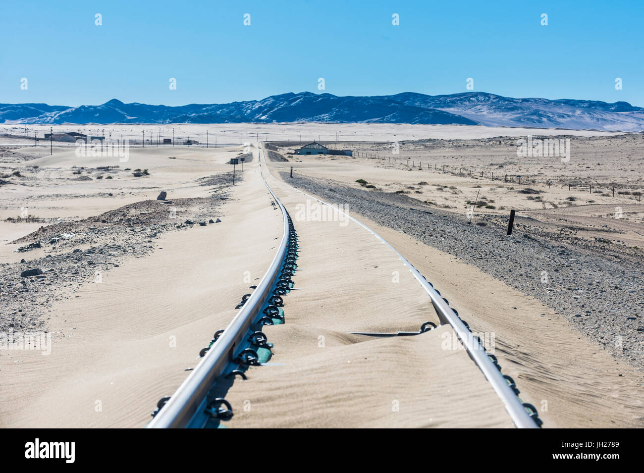 Railway tracks overflown by sand, old diamond ghost town, Kolmanskop, near Luderitz, Namibia, Africa - Stock Image