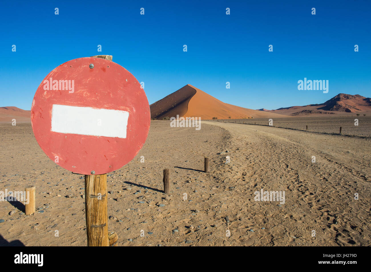 No passing sign in front of the giant sand Dune 45, Sossusvlei, Namib-Naukluft National Park, Namibia, Africa - Stock Image