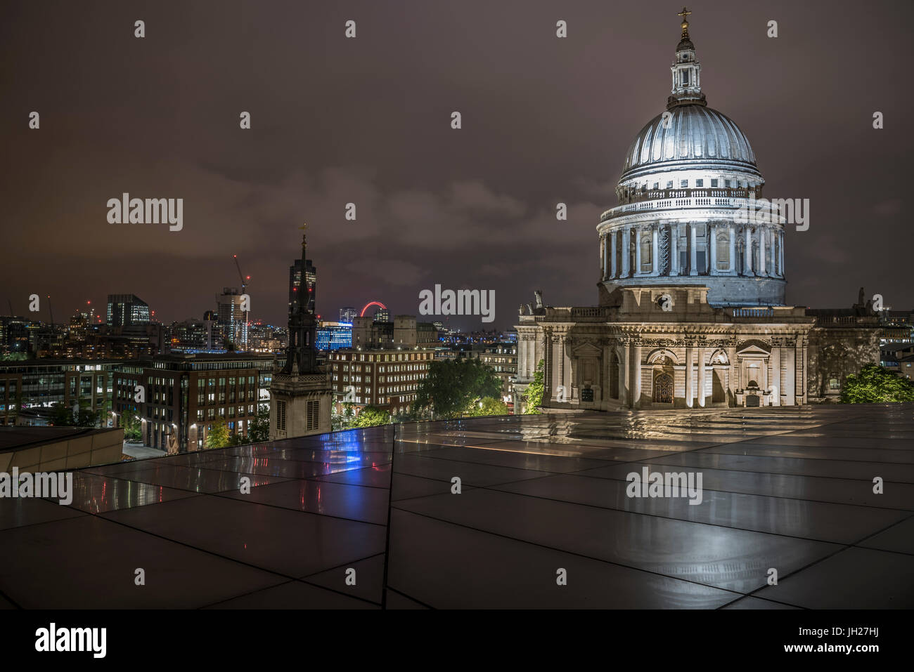 Floodlit dome of St. Pauls Cathedral at night from One New Change, City of London, London, England, United Kingdom, - Stock Image