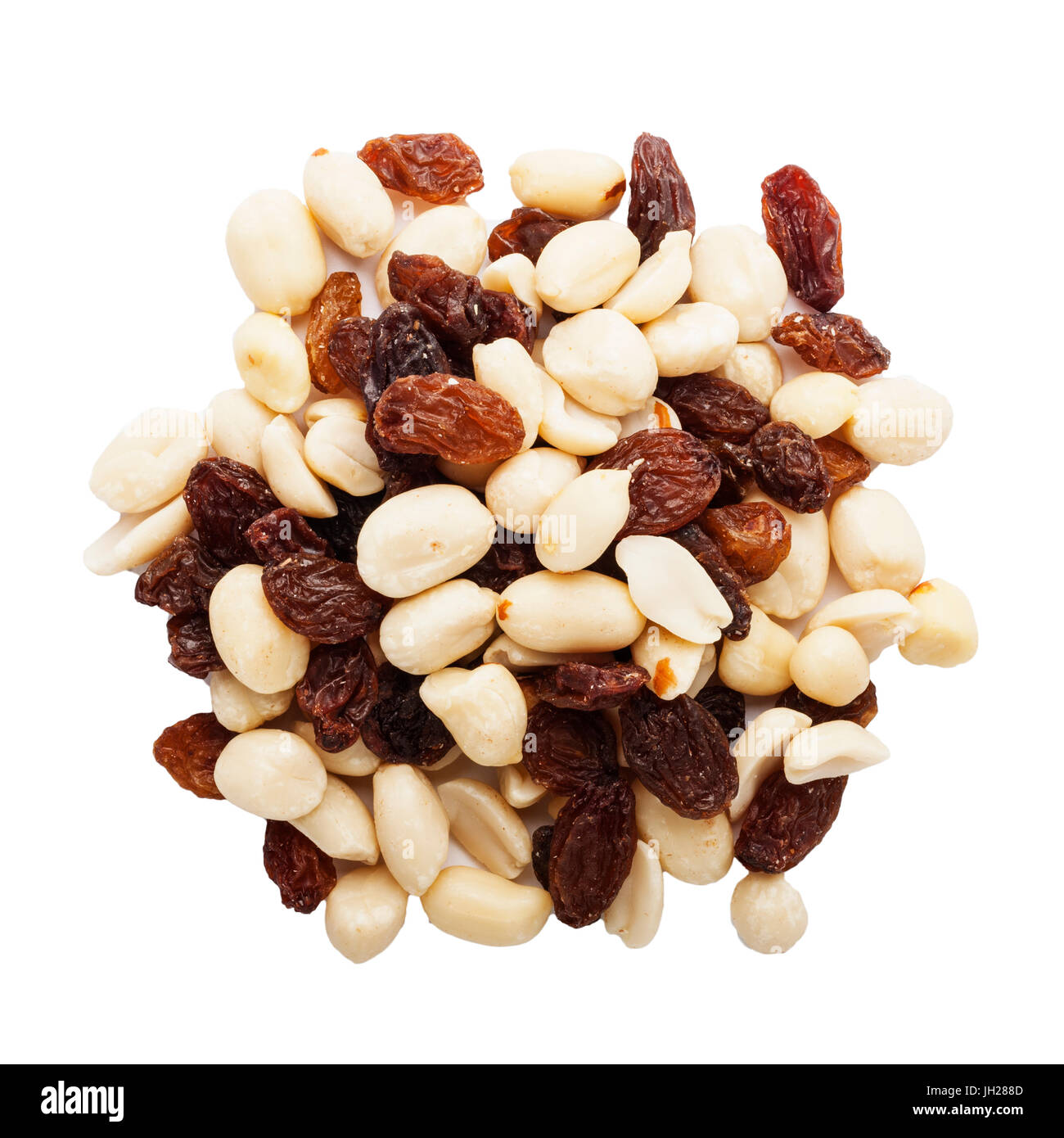 Peanuts and raisins on a white background - Stock Image