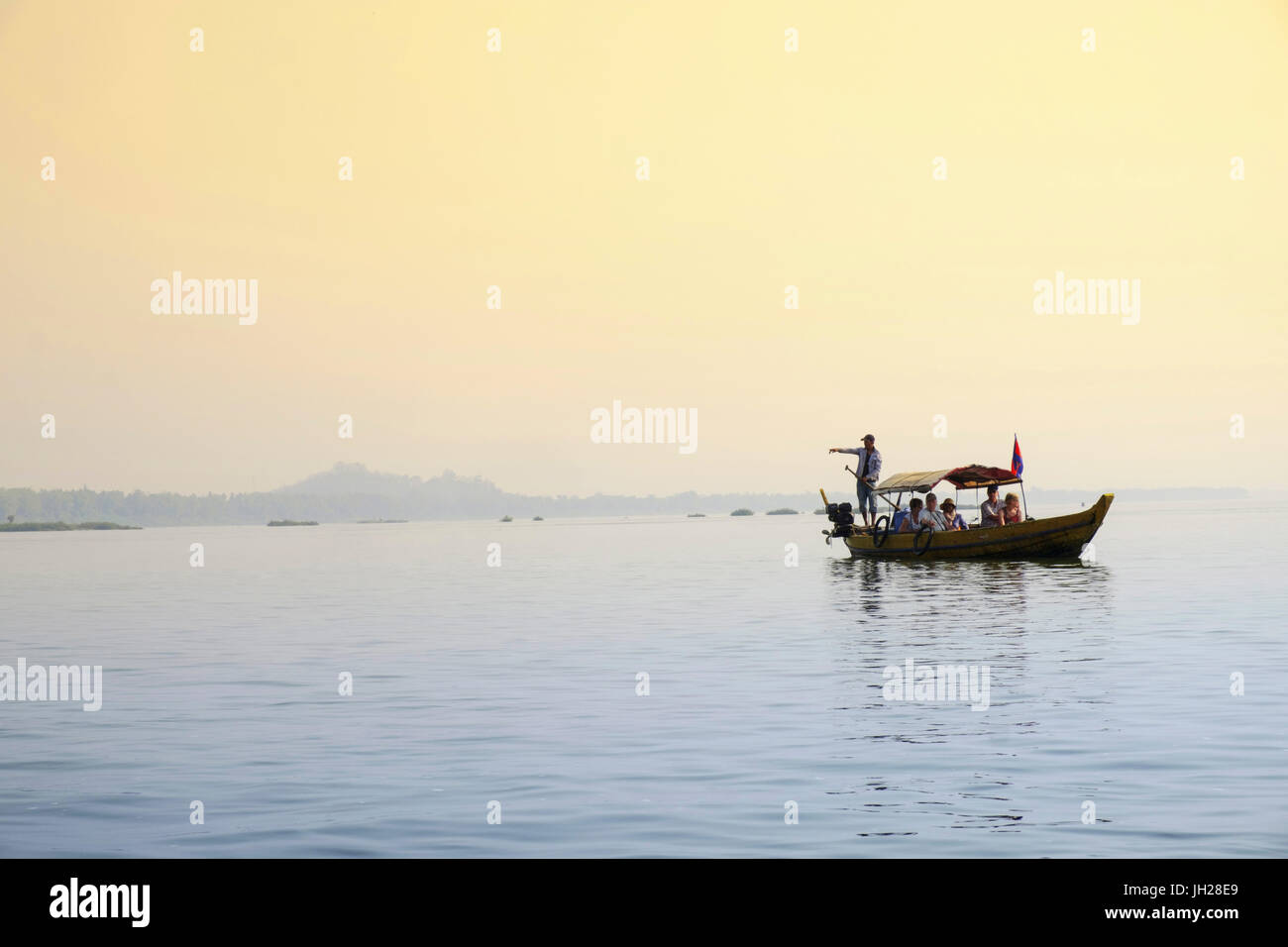 Tourist boat river dolphin-watching on the Mekong River, Kratie, Cambodia, Indochina, Southeast Asia, Asia - Stock Image