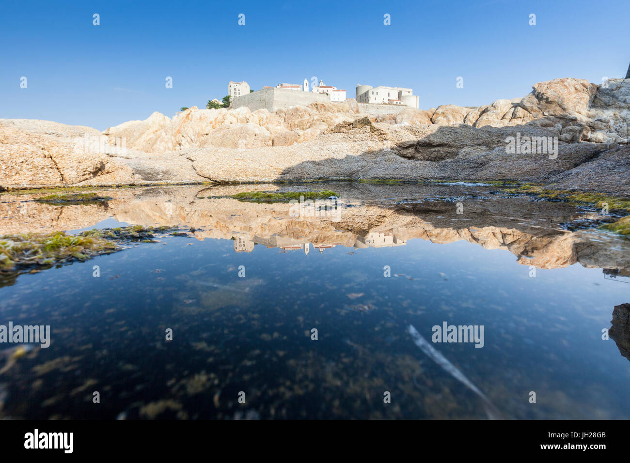 The ancient fortified citadel reflected in the blue sea, Calvi, Balagne Region, Corsica, France, Mediterranean, - Stock Image
