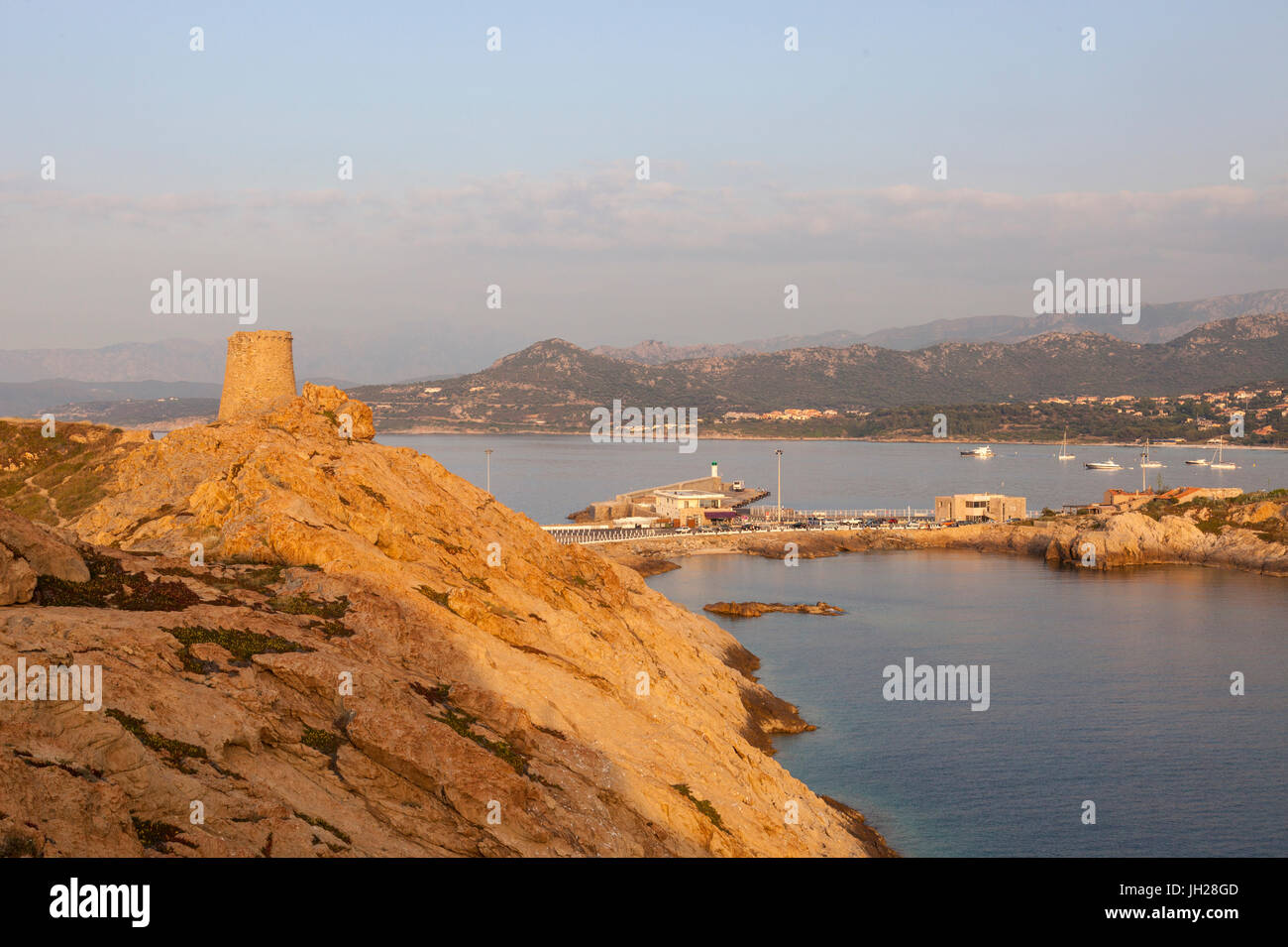 The ancient Genoese tower overlooking the blue sea surrounding the village of Ile Rousse, Balagne Region, Corsica, - Stock Image