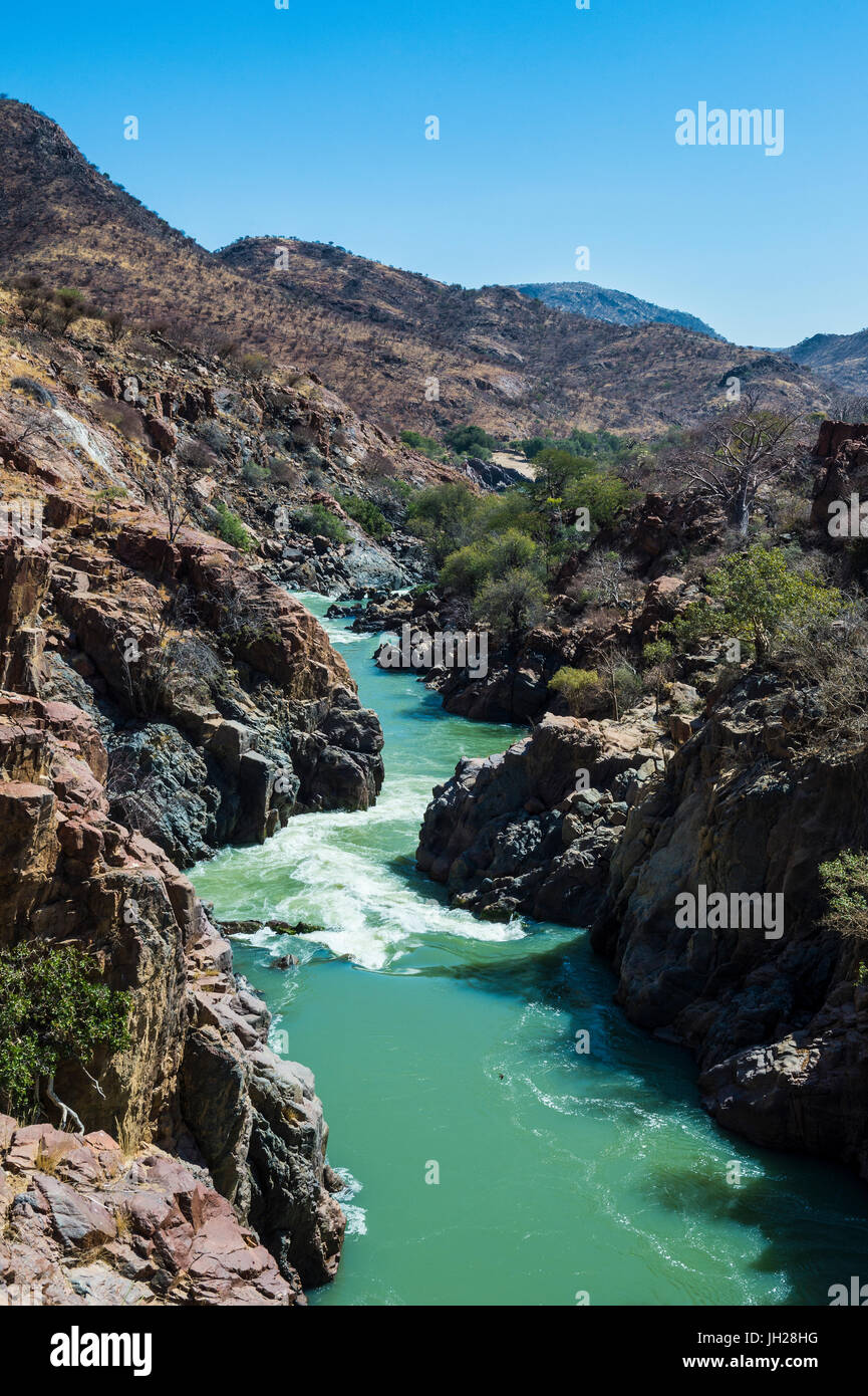 Epupa Falls on the Kunene River on the border between Angola and Namibia, Namibia, Africa - Stock Image