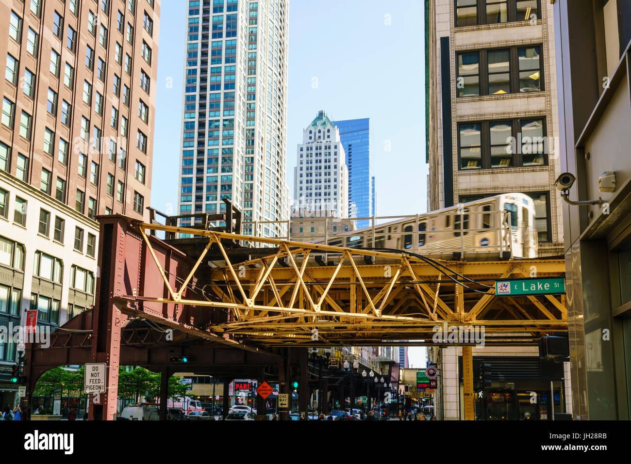 CTA train on the Loop track which runs above ground in downtown Chicago, Illinois, United States of America, North - Stock Image