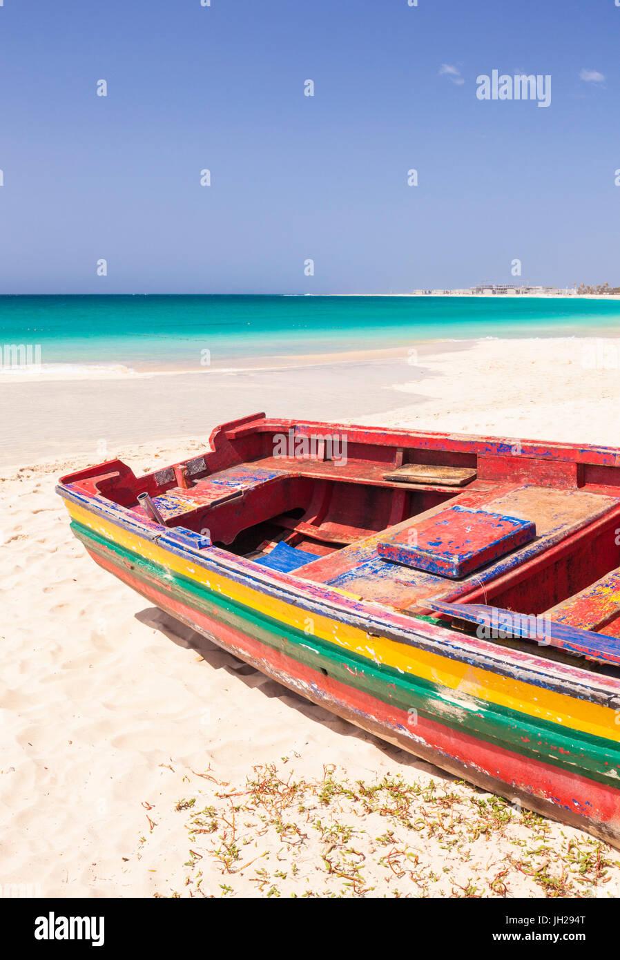 Colourful traditional local fishing boat on the beach at Santa Maria, Praia da Santa Maria, Sal Island, Cape Verde, - Stock Image