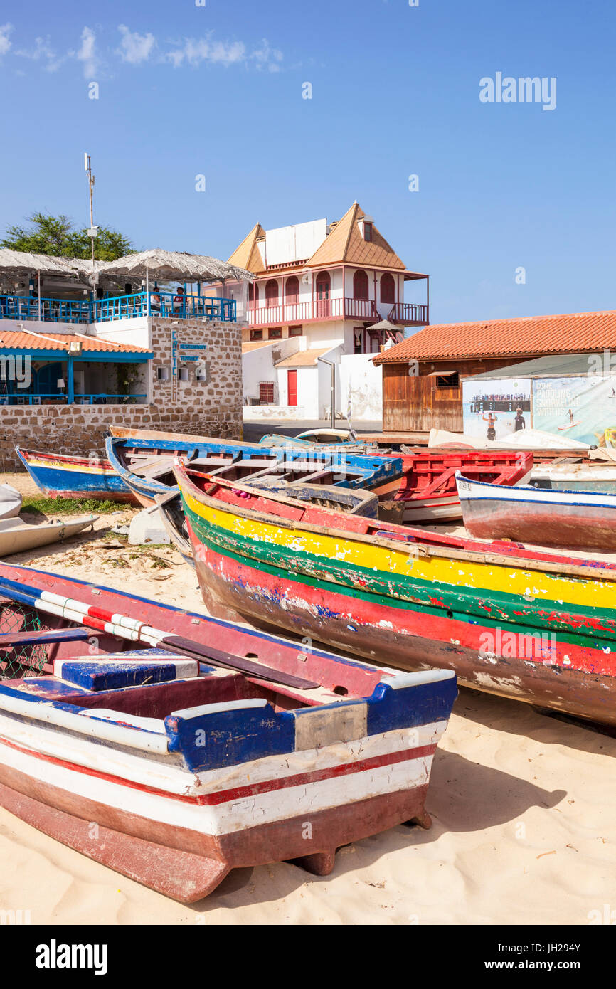 Colourful traditional local fishing boats on the beach at Santa Maria, Praia da Santa Maria, Sal Island, Cape Verde, - Stock Image