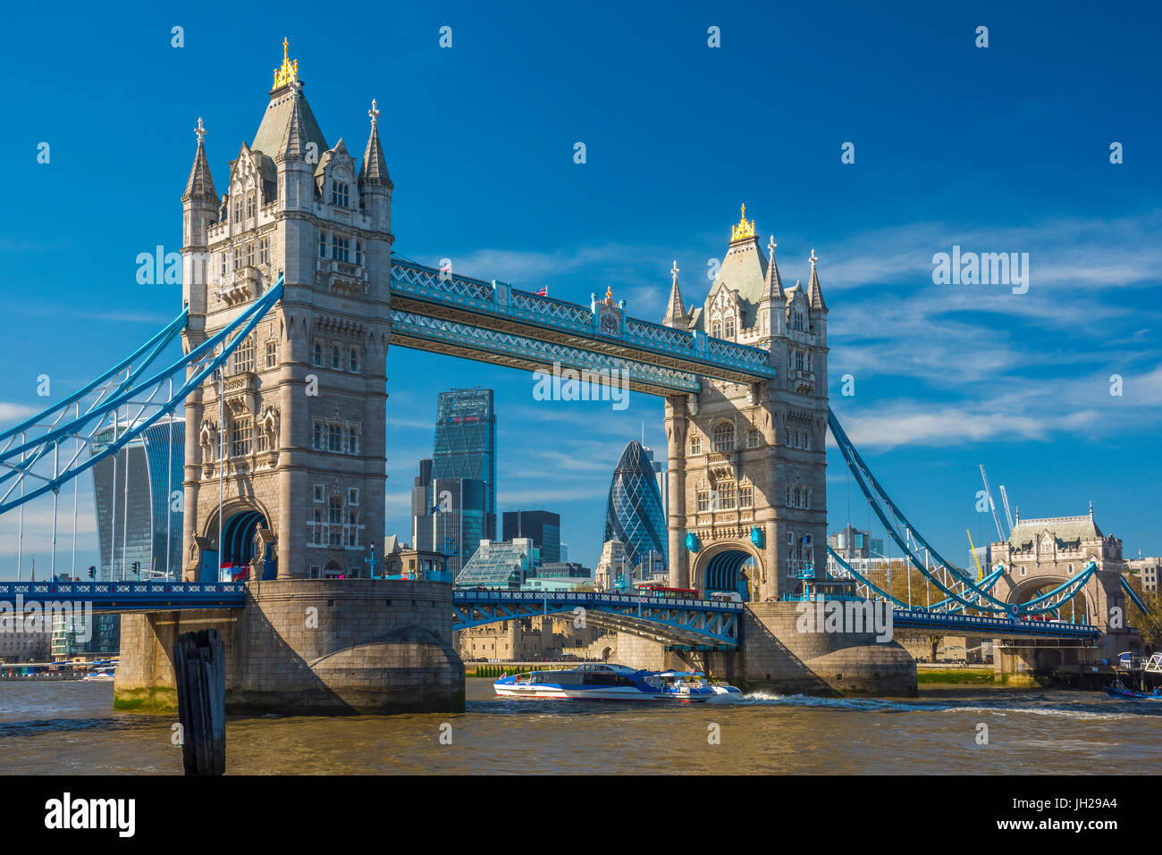Tower Bridge over River Thames, City skyline including Cheesegrater and Gherkin skyscrapers beyond, London, England, - Stock Image