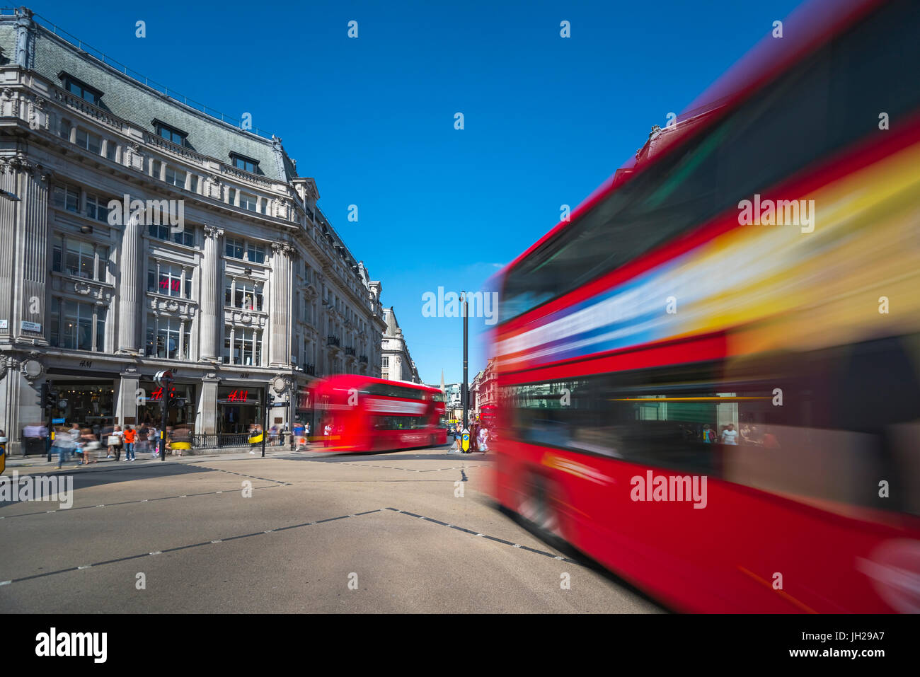 Double decker buses, Oxford Circus, West End, London, England, United Kingdom, Europe - Stock Image