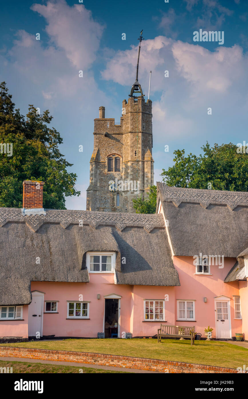 St. Mary the Virgin's Church and the Pink Cottages, Cavendish, Suffolk, England, United Kingdom, Europe - Stock Image
