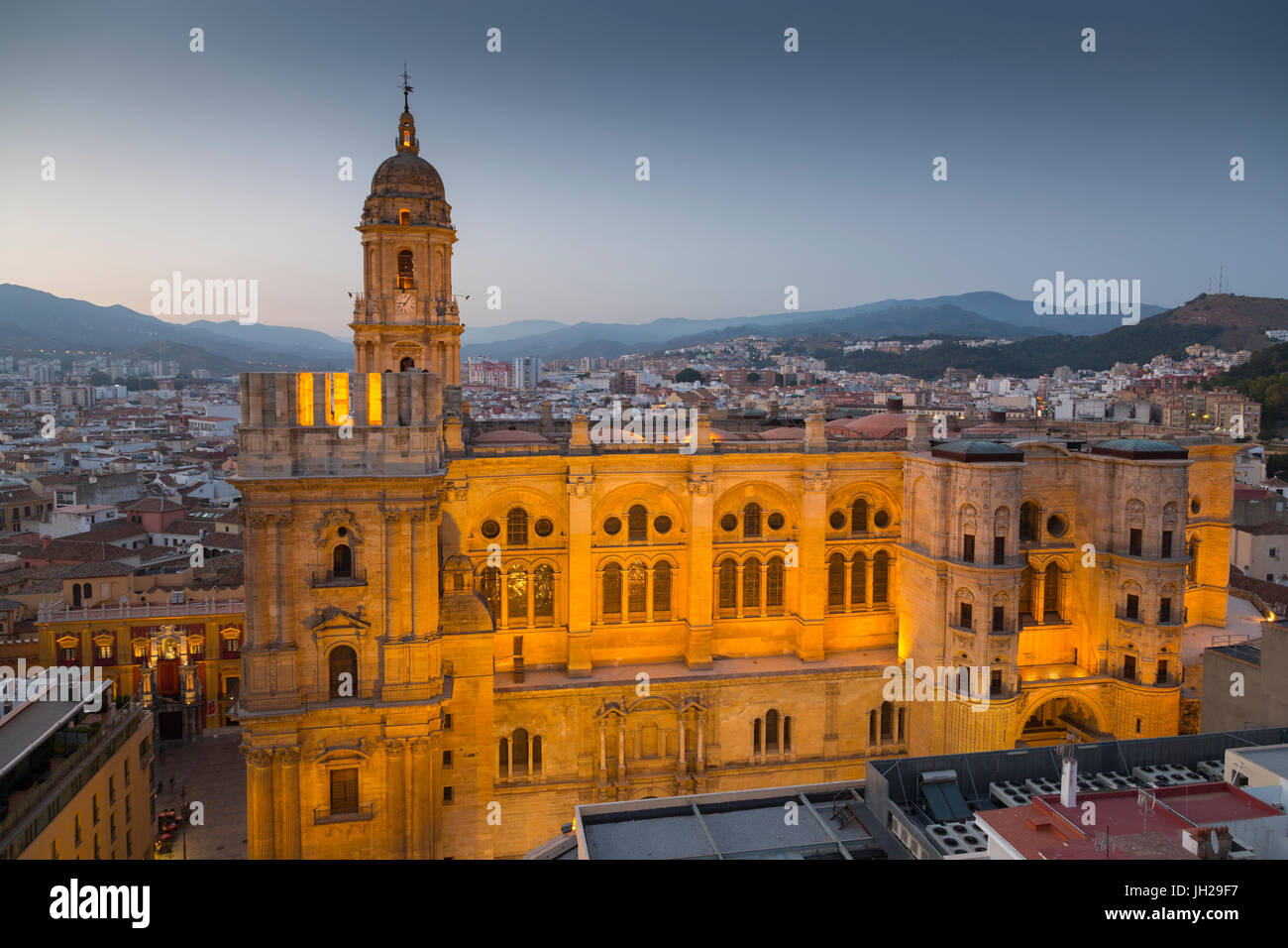 Elevated view of Malaga Cathedral at dusk, Malaga, Costa del Sol, Andalusia, Spain, Europe - Stock Image