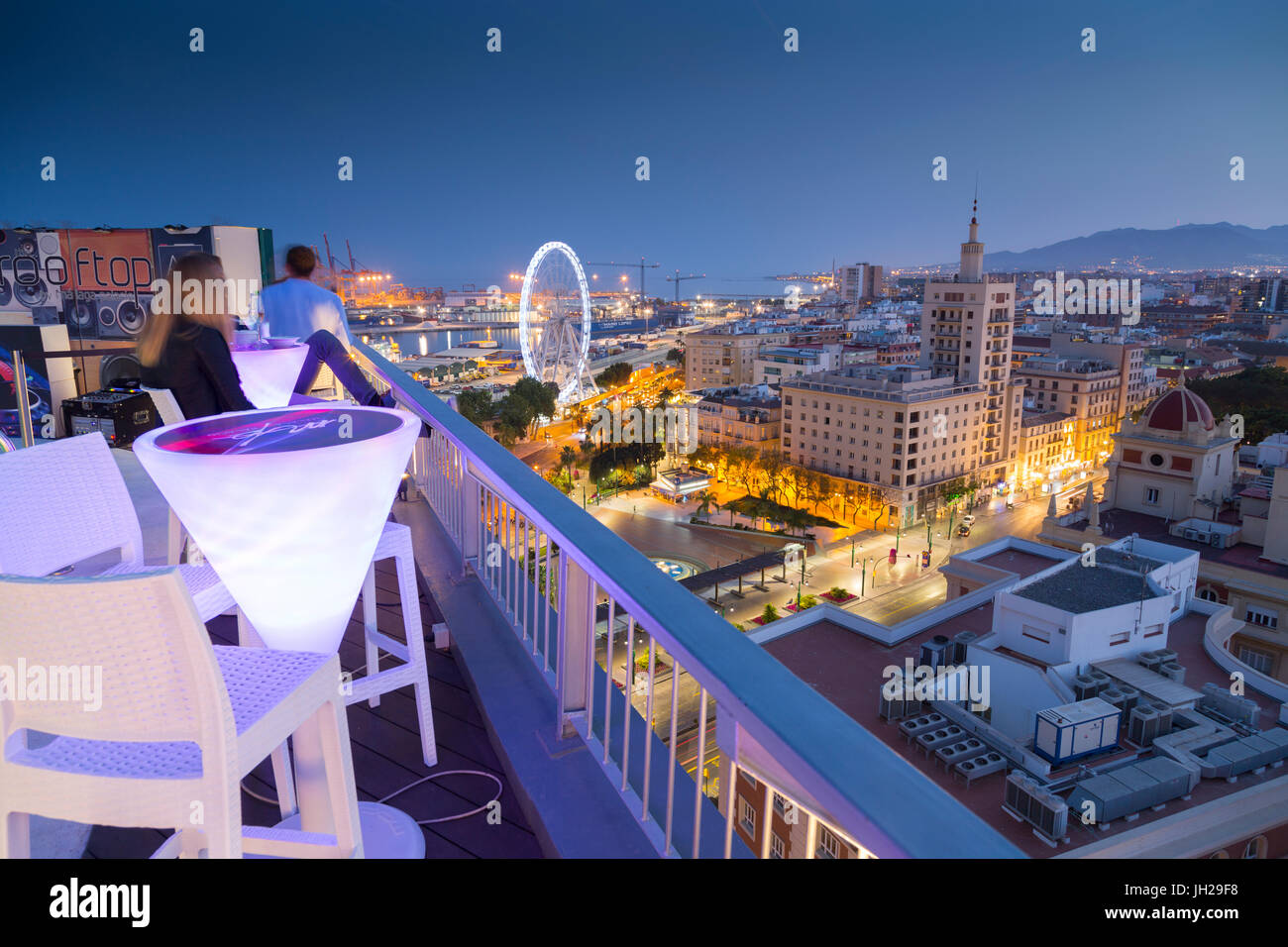 Elevated view of Malaga Marina and old town at dusk, Malaga, Costa del Sol, Andalusia, Spain, Europe - Stock Image