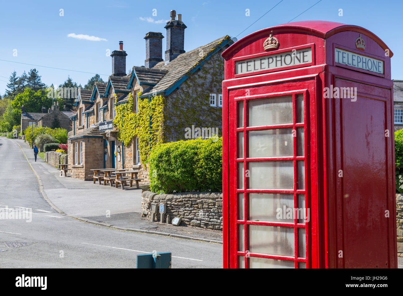 Red telephone box in Beeley Village in springtime, Derbyshire Dales, Derbyshire, England, United Kingdom, Europe - Stock Image