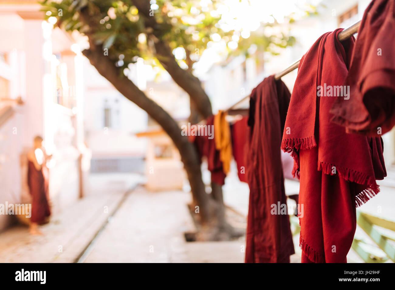 Buddhist monks' robes hanging to dry, Amarapura, Mandalay, Mandalay Region, Myanmar (Burma), Asia - Stock Image