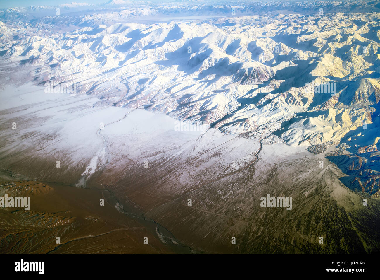 Flight over Pamir and Tien Shan 5. Visible deep mountain valley and multitude of parallel ridges. - Stock Image