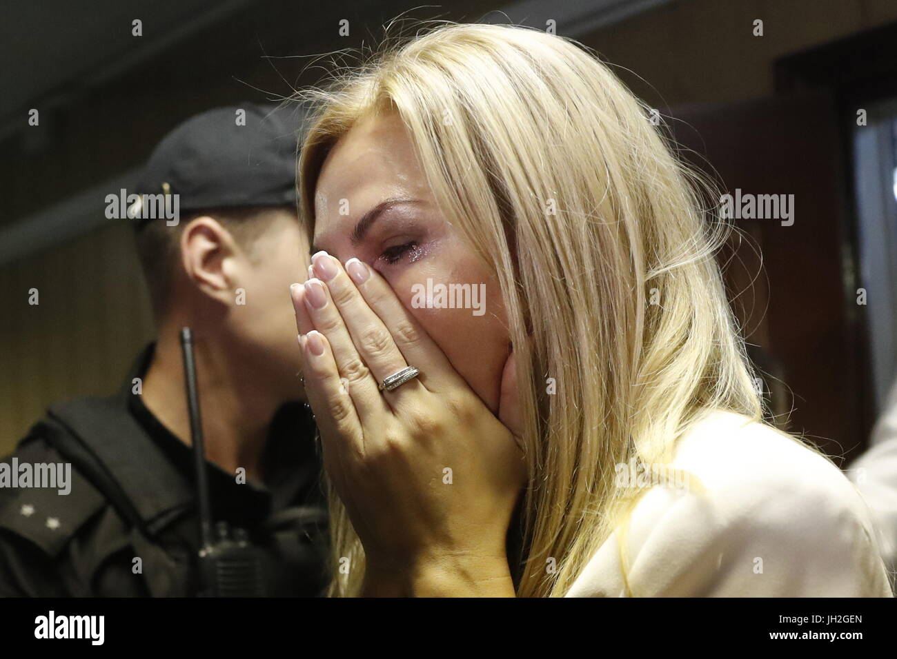 MOSCOW, RUSSIA – JULY 12, 2017: Russian real estate tycoon Sergei Polonsky's wife Olga Deripasko (C) reacts - Stock Image