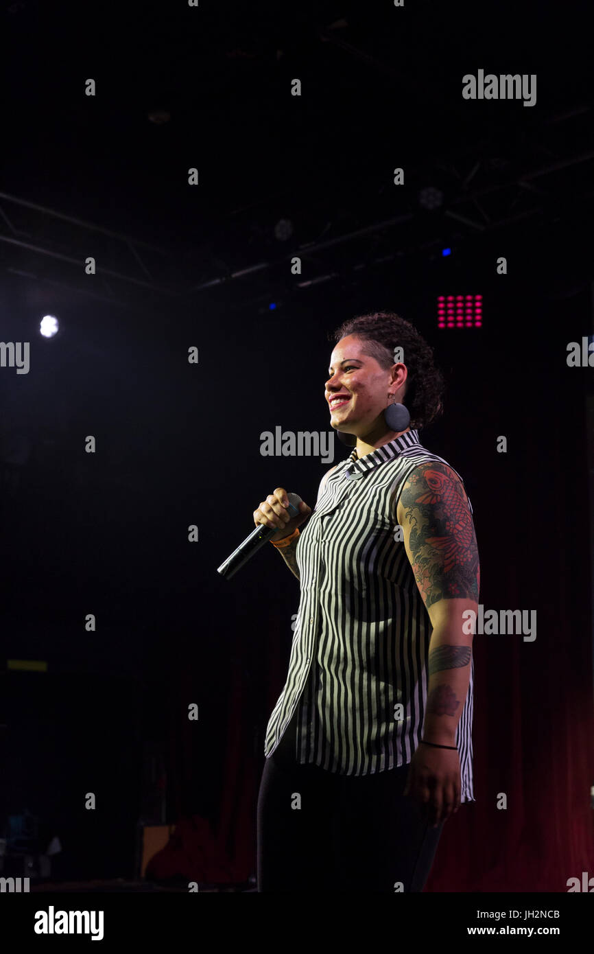 Seattle, Washington, USA. 11th July, 2017. Lawyer and educator Nikkita Oliver performs for the audience at Candidate Stock Photo