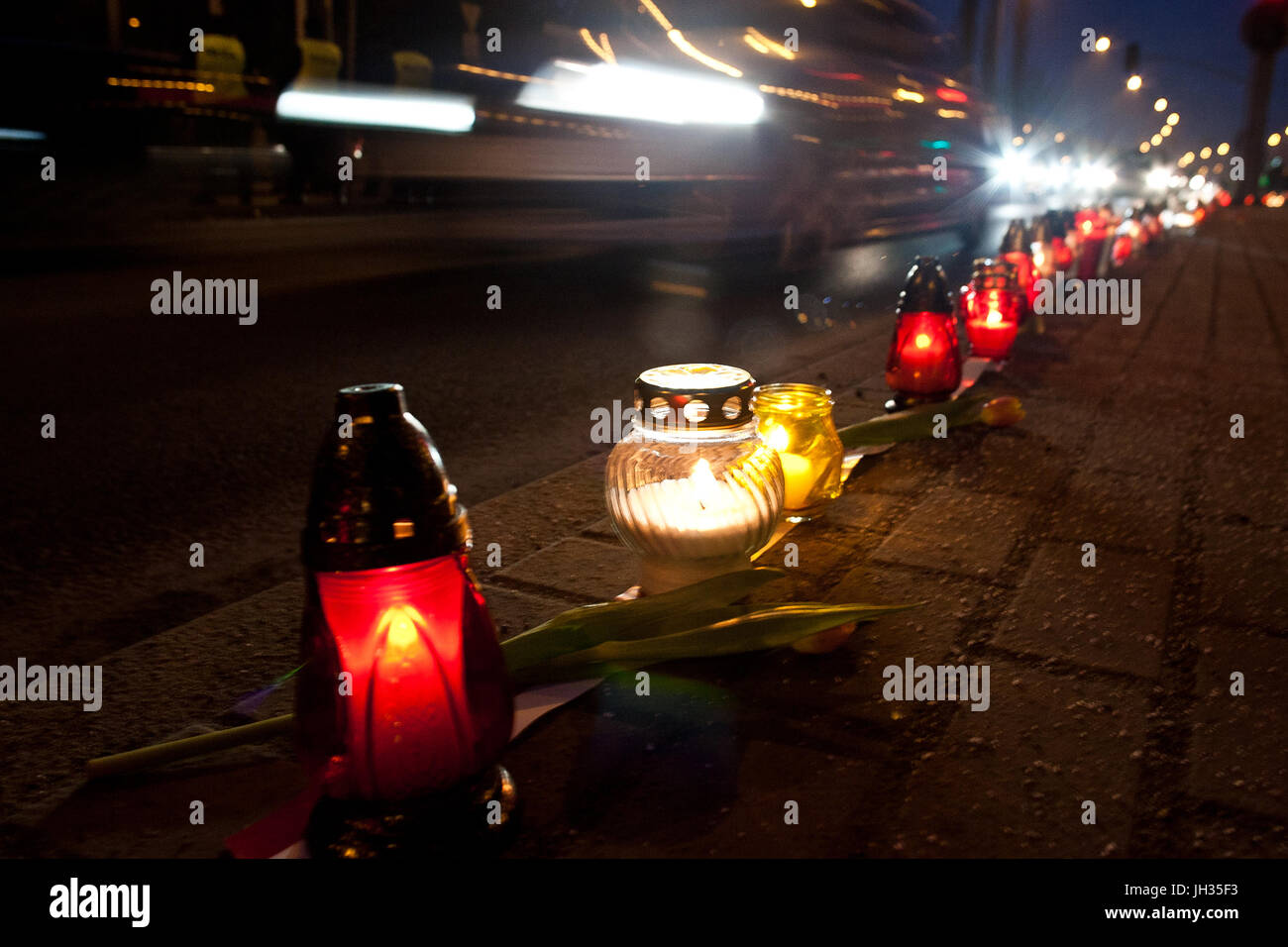 Road traffic accident night candles flowers - Stock Image