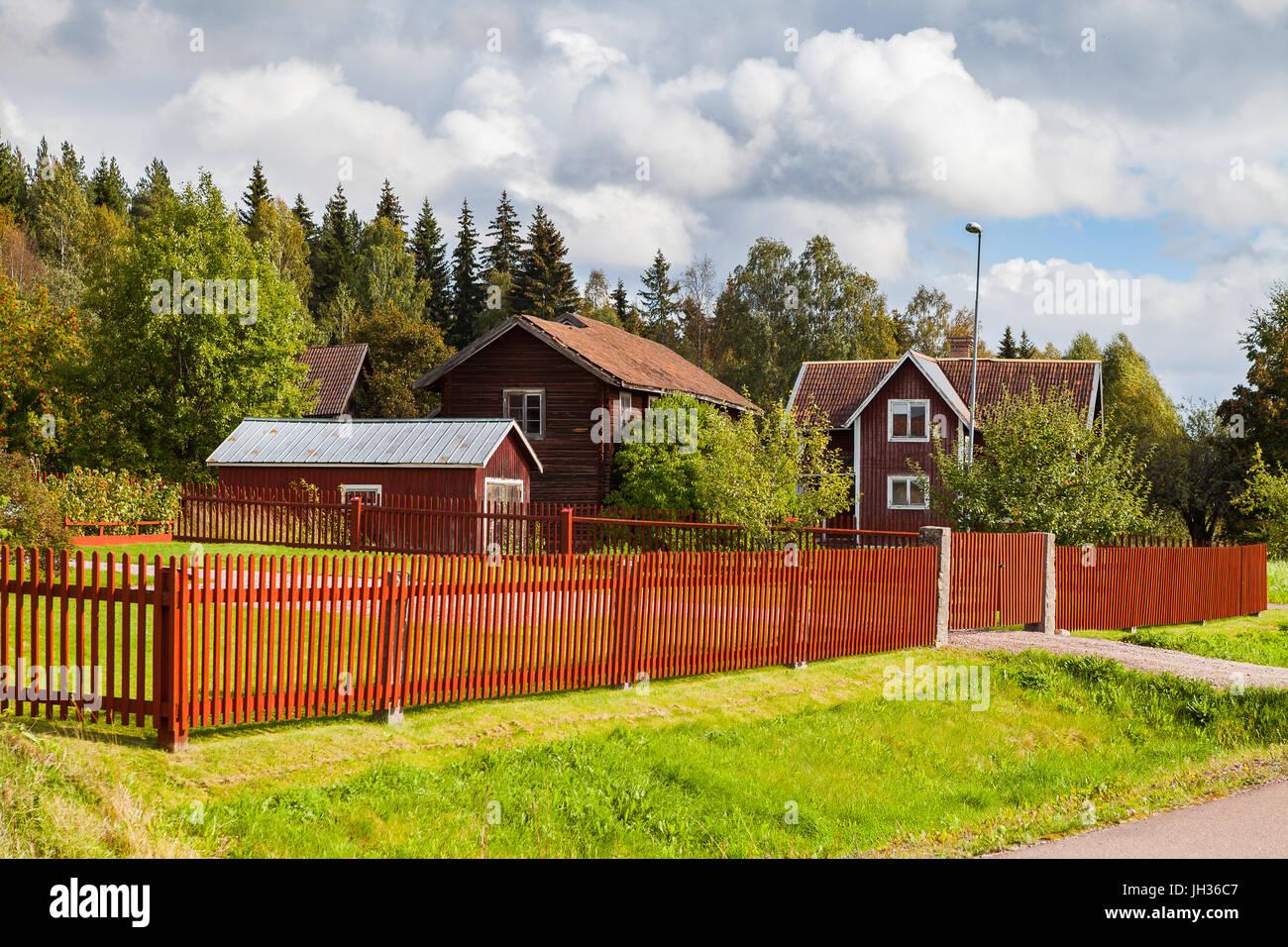 Typical scandinavian wooden houses in village. Dalarna county, Sweden. - Stock Image