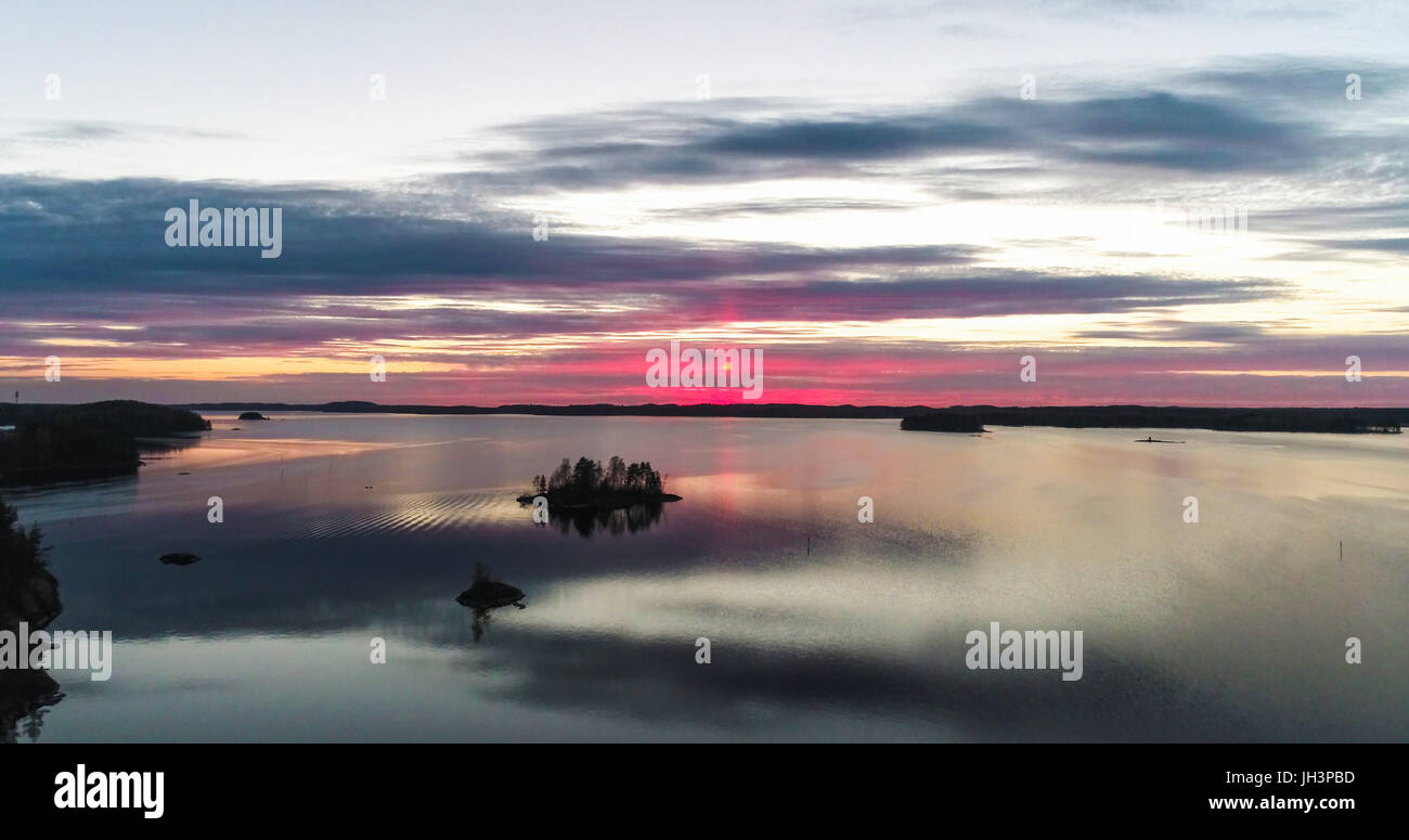 Aerial view of a red sunset at mirroring lake saimaa, in Savonlinna, Savo, Finland Stock Photo