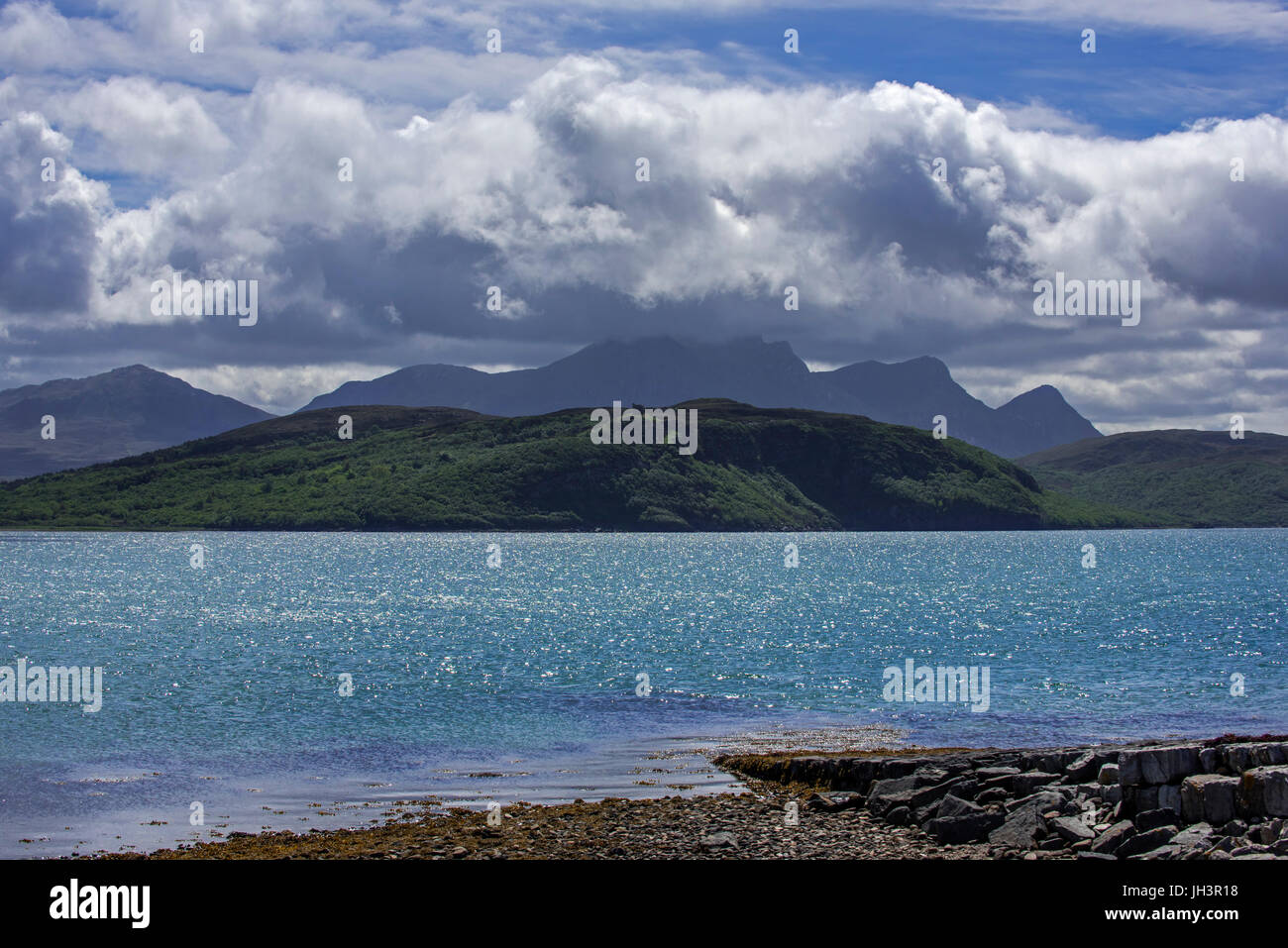 Rain clouds forming over Ben Loyal on west side of Kyle of Tongue, shallow sea loch in northwest Highland, Sutherland, - Stock Image
