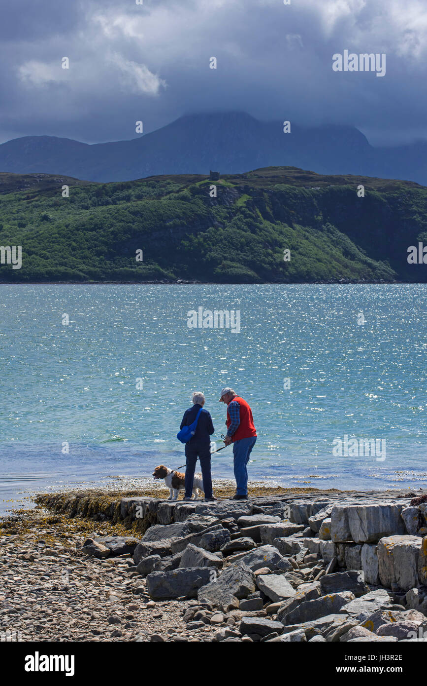 Tourists looking over Ben Loyal and Kyle of Tongue, shallow sea loch in northwest Highland, Sutherland, Scottish - Stock Image