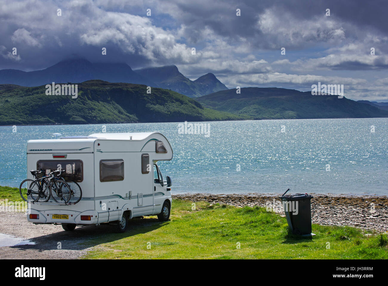 Motorhome parked on the shore along Kyle of Tongue, shallow sea loch in northwest Highland, Sutherland, Scottish - Stock Image