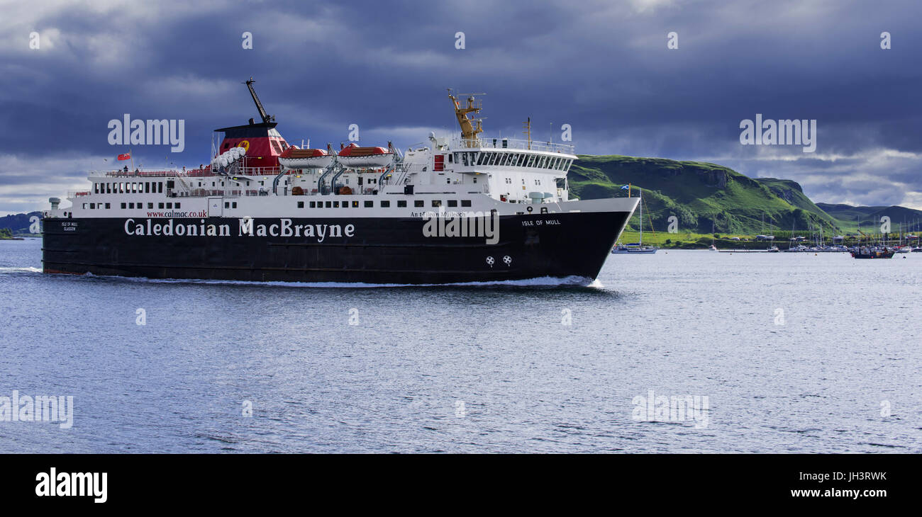 Isle of Mull ferry boat from Caledonian MacBrayne leaving the Oban port and sailing to Craignure, Argyll and Bute, Stock Photo
