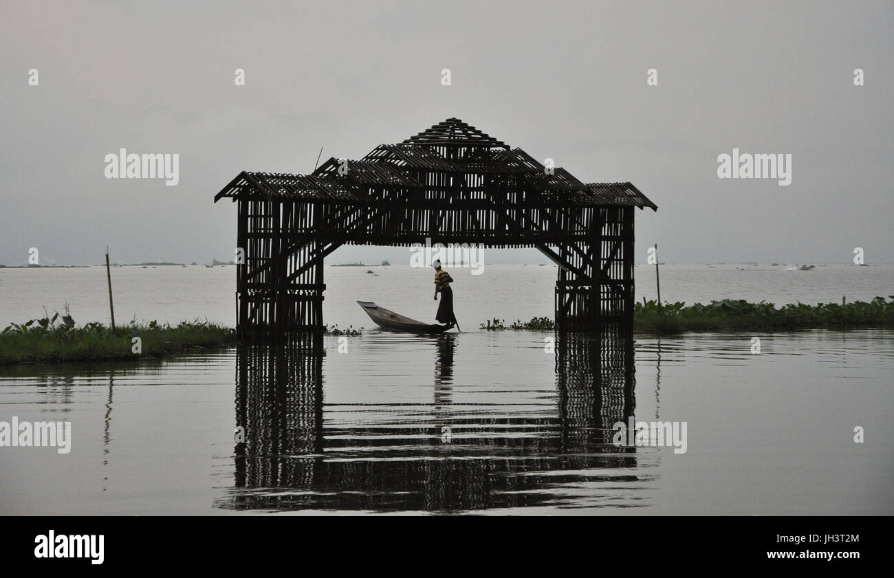 Wooden gate on Inle lake in Shan state, Myanmar. The Inle Lake is famous for its floating villages and the unique - Stock Image