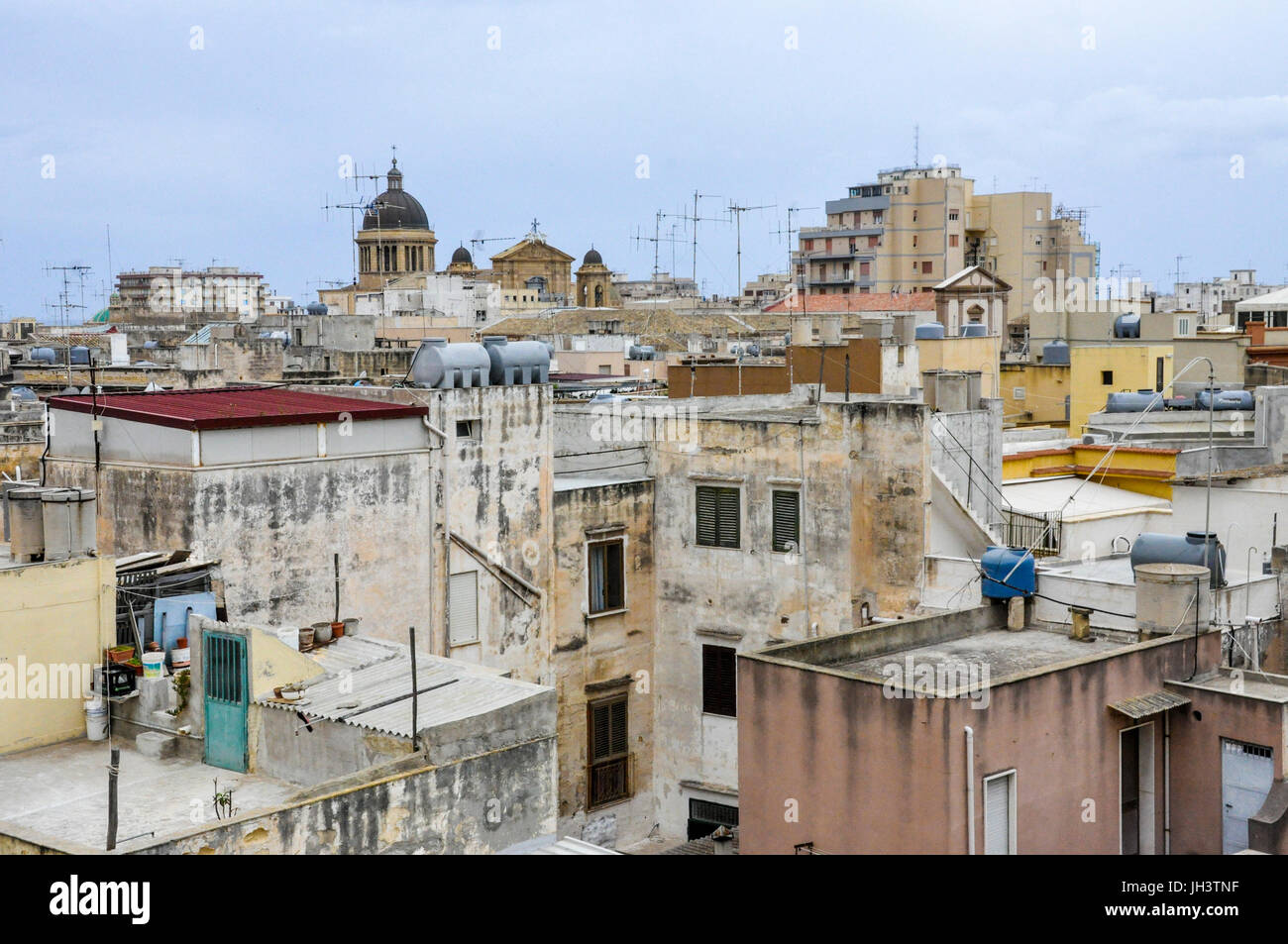 Television aerials on the rooftops of apartments in the town of Marsala, Trapani, Sicily, Italy. - Stock Image
