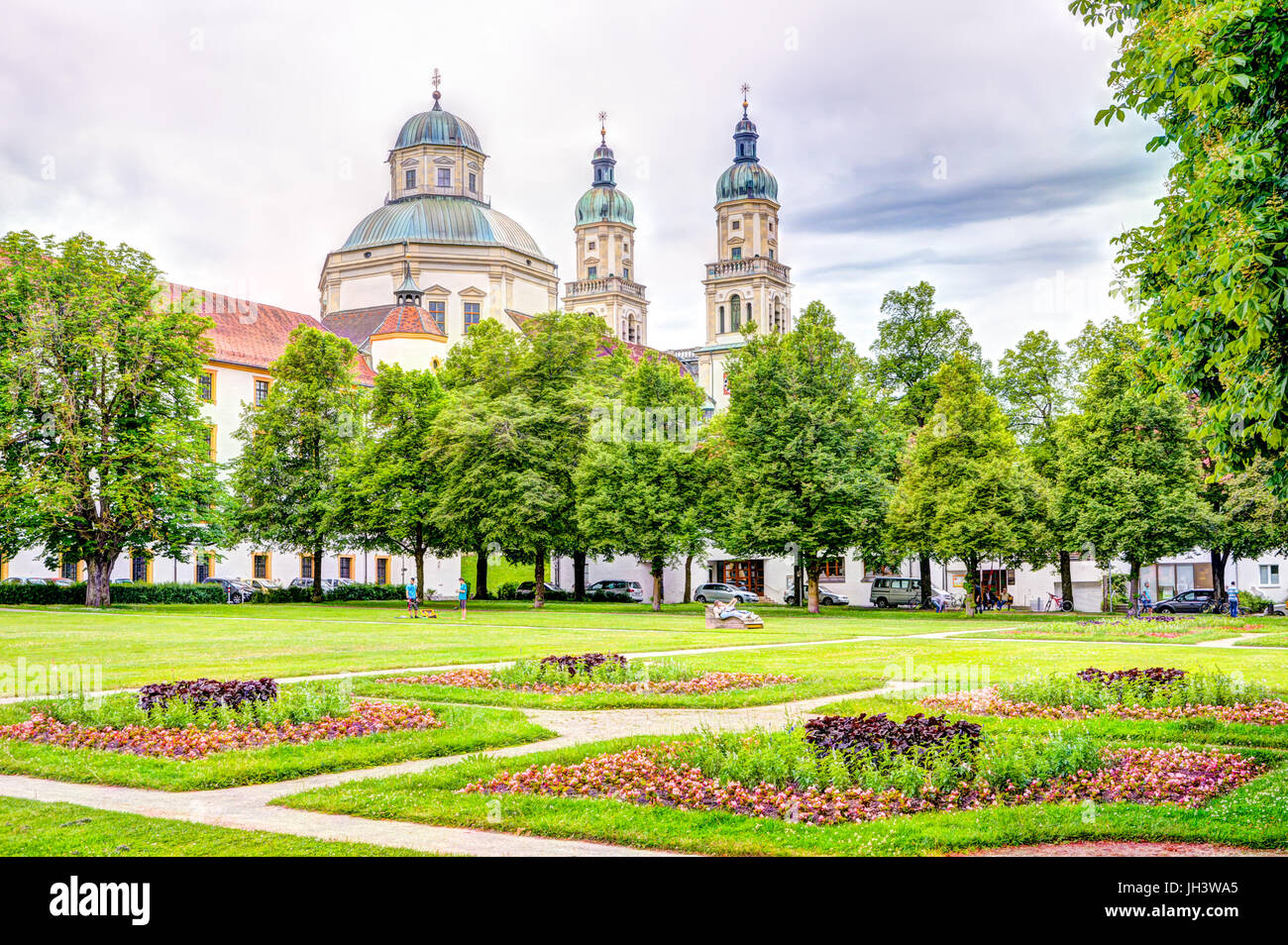 KEMPTEN, GERMANY - JUNE 9: People in park at the Basilica of Keptem, Germany on June 9, 2017. Kempten is one of - Stock Image