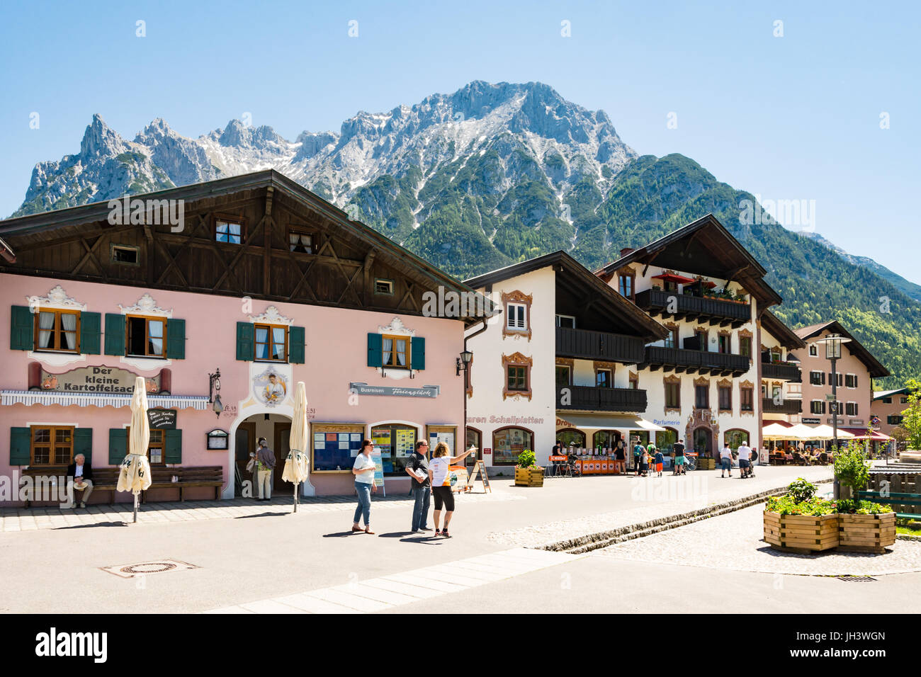 MITTENWALD, GERMANY - MAY 27: Tourists at the historic old town of Mittenwald, Germany on May 27, 2017. Mittenwald - Stock Image