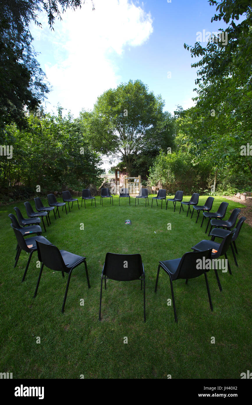 Chairs set up for Channel Therapy session, group therapy session, informal group sit in a circle and respond in - Stock Image