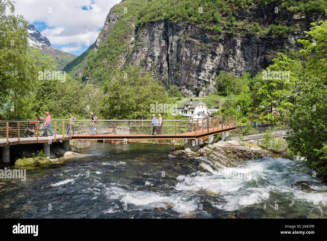 Pedestrian walkway and footbridge over Geirangelva river to village of Geiranger, Sunnmøre region, Møre - Stock Image