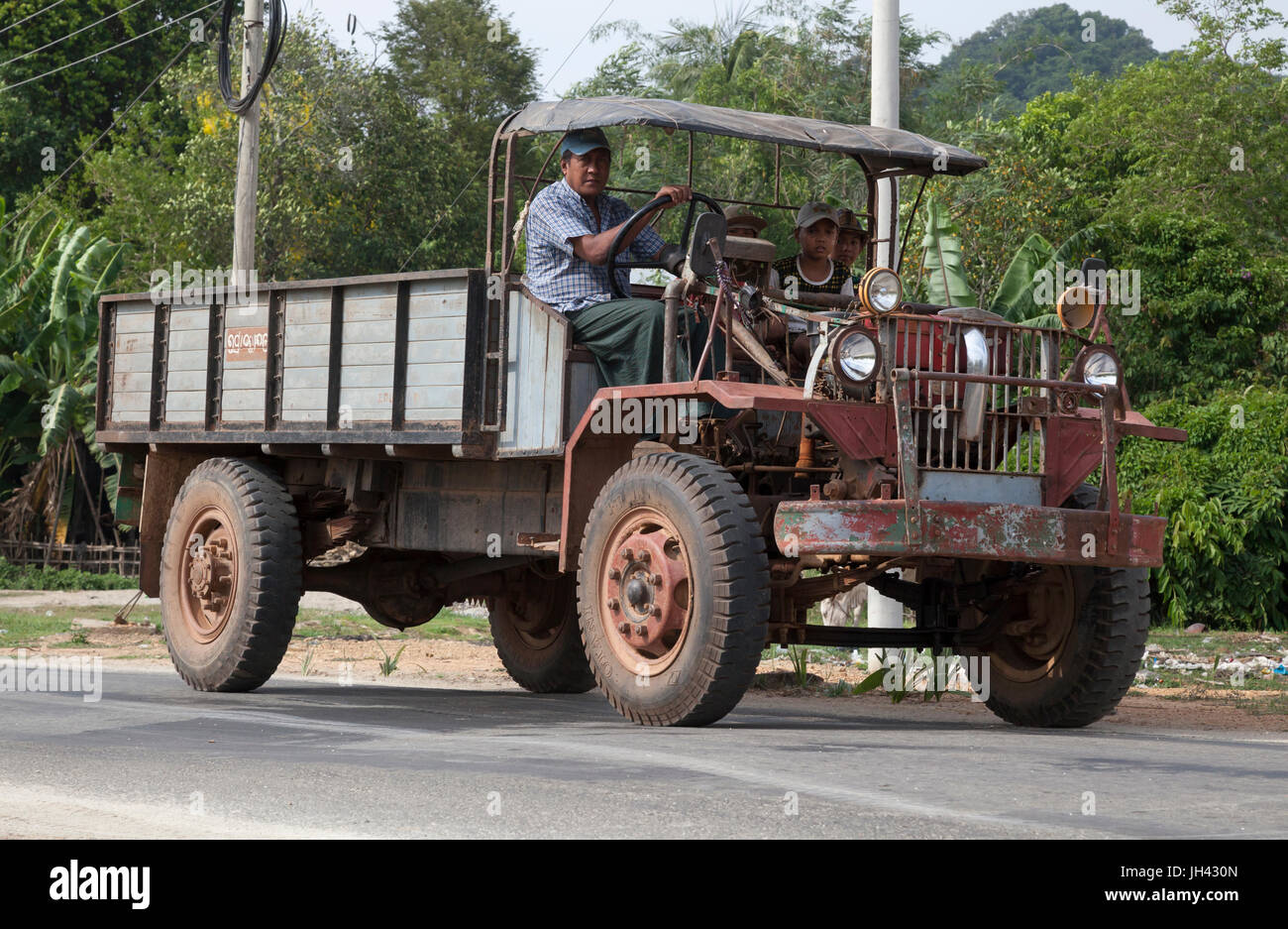 Vintage truck still in widespread use today in Myanmar. Modified from a WW2 ex British armyCanadian Military Pattern Stock Photo