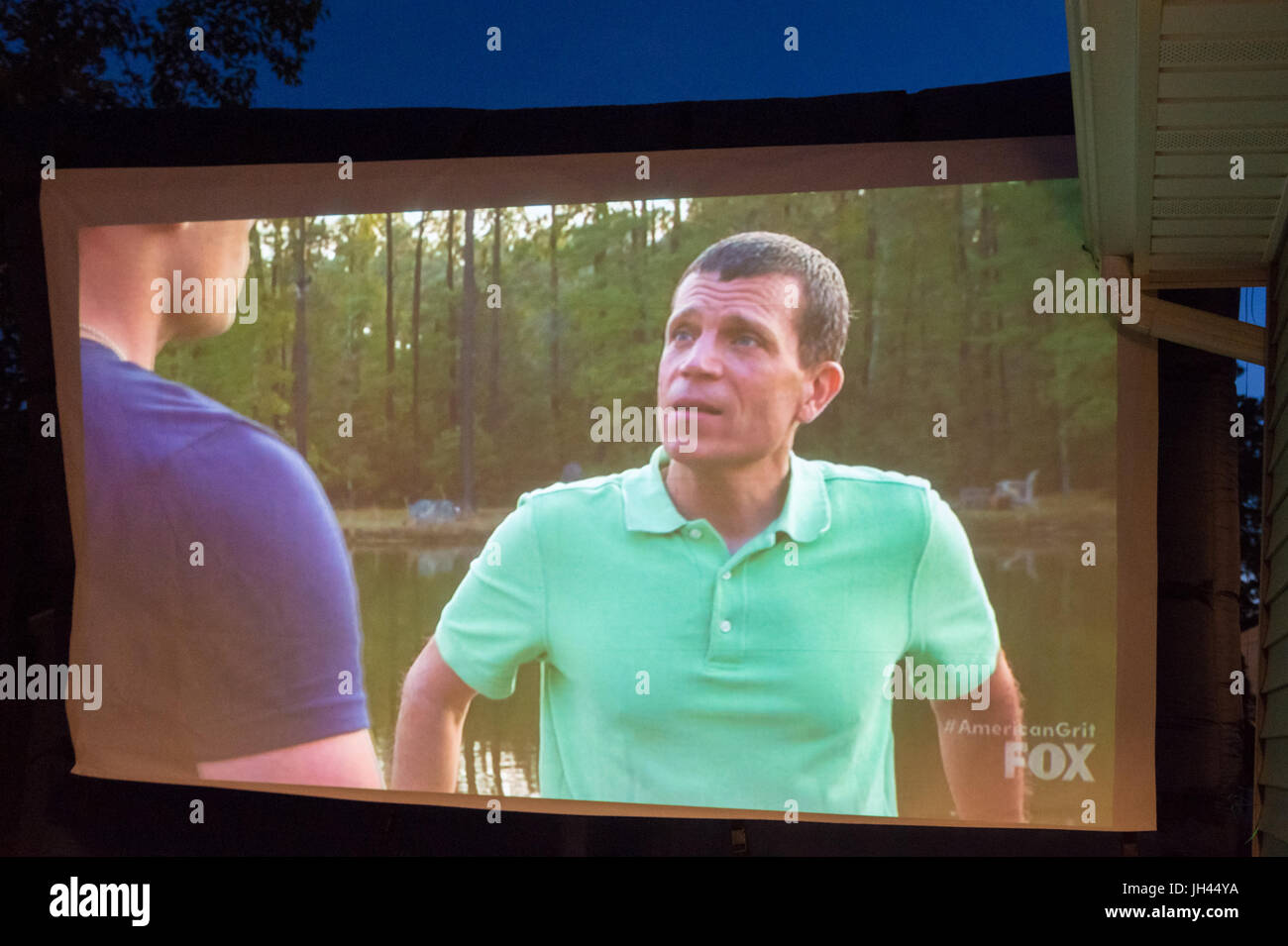 """Merrick, New York, USA. 11th June 2017.  On large TV screen, """"American Grit"""" TV show contestant CHRIS EDOM (at right), Stock Photo"""