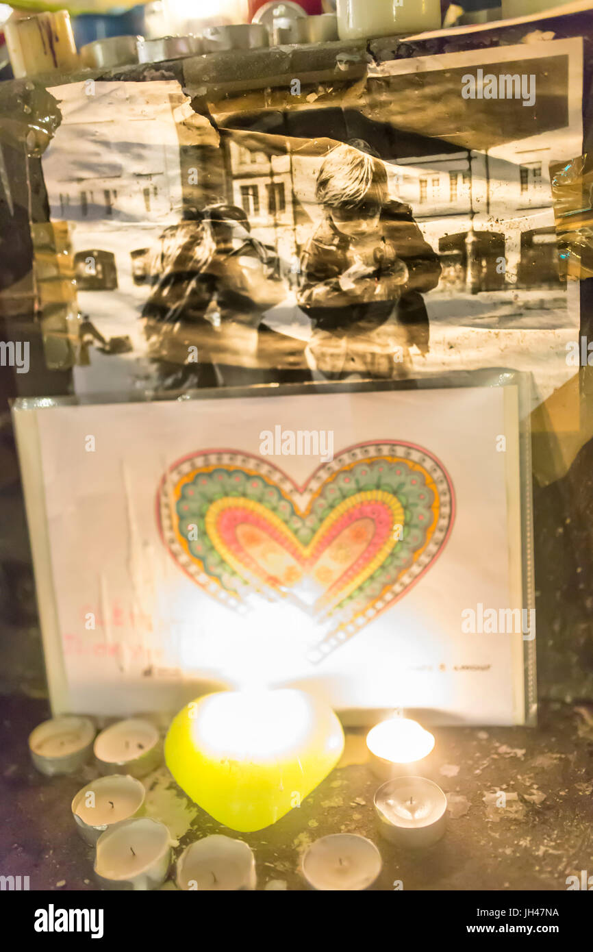 heart drawing and photo of victim in the glimmer of a candle. Homage at the victims of the terrorist attacks in - Stock Image